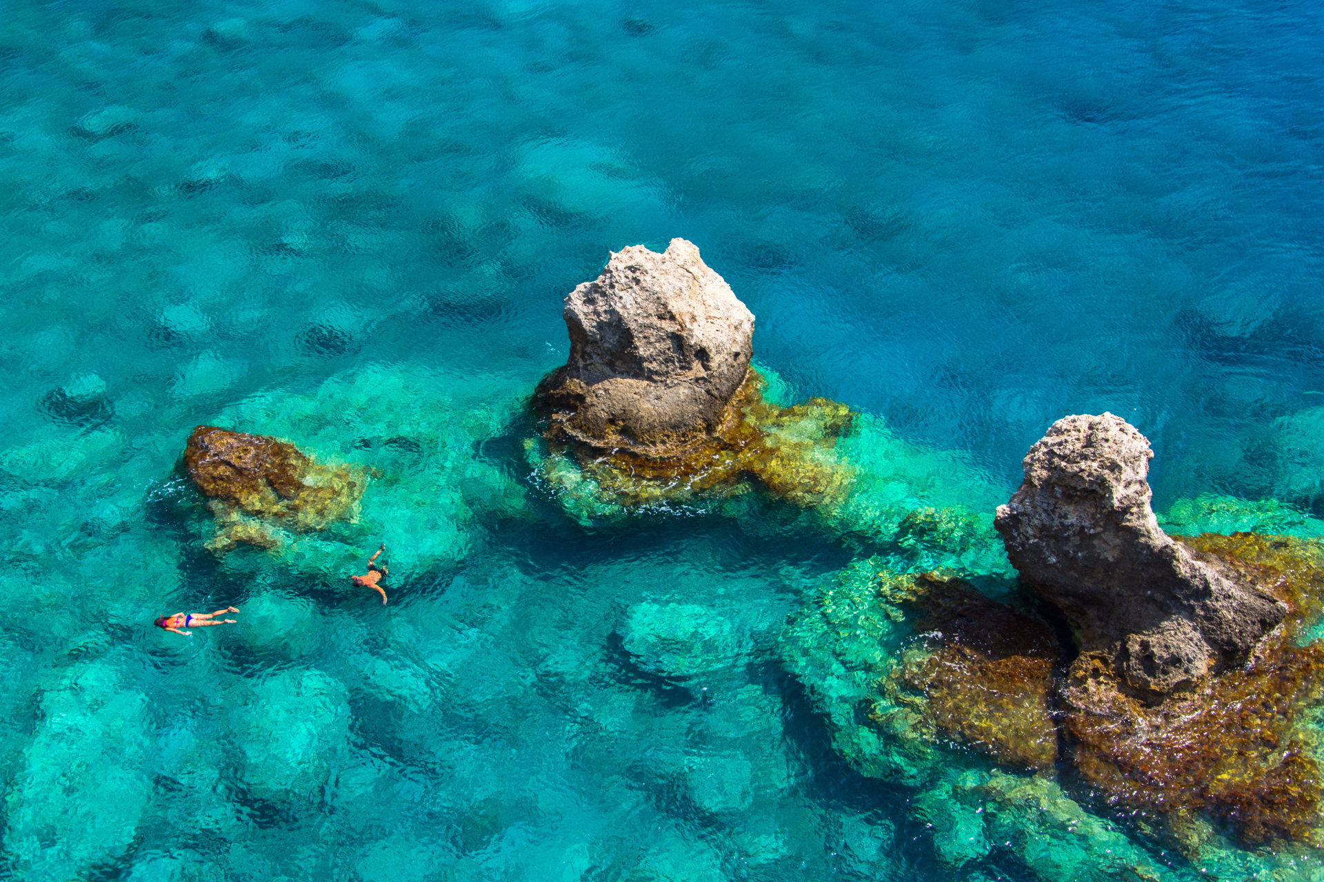 Above view of couple snorkeling in turquoise sea water, Glyka Nera, Chania