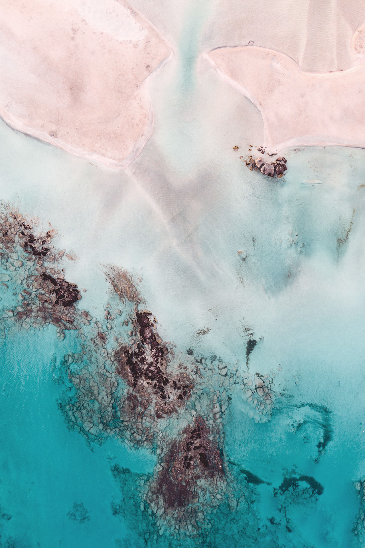 Balos is surrounded by all that white sand and shimmering flecks of pink from crushed shell