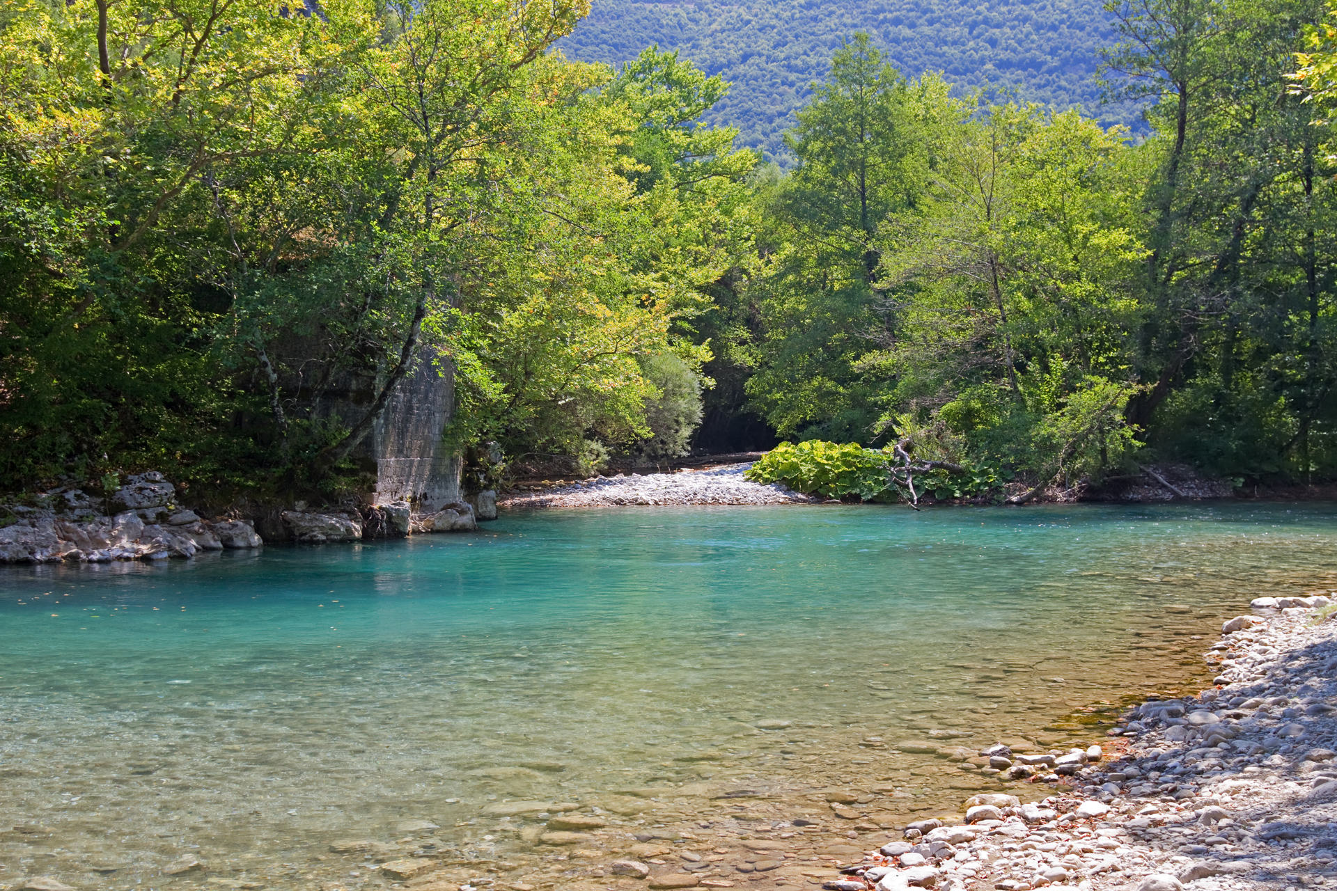 The blue waters of Voidomatis river that flows through Epirus region, Greece