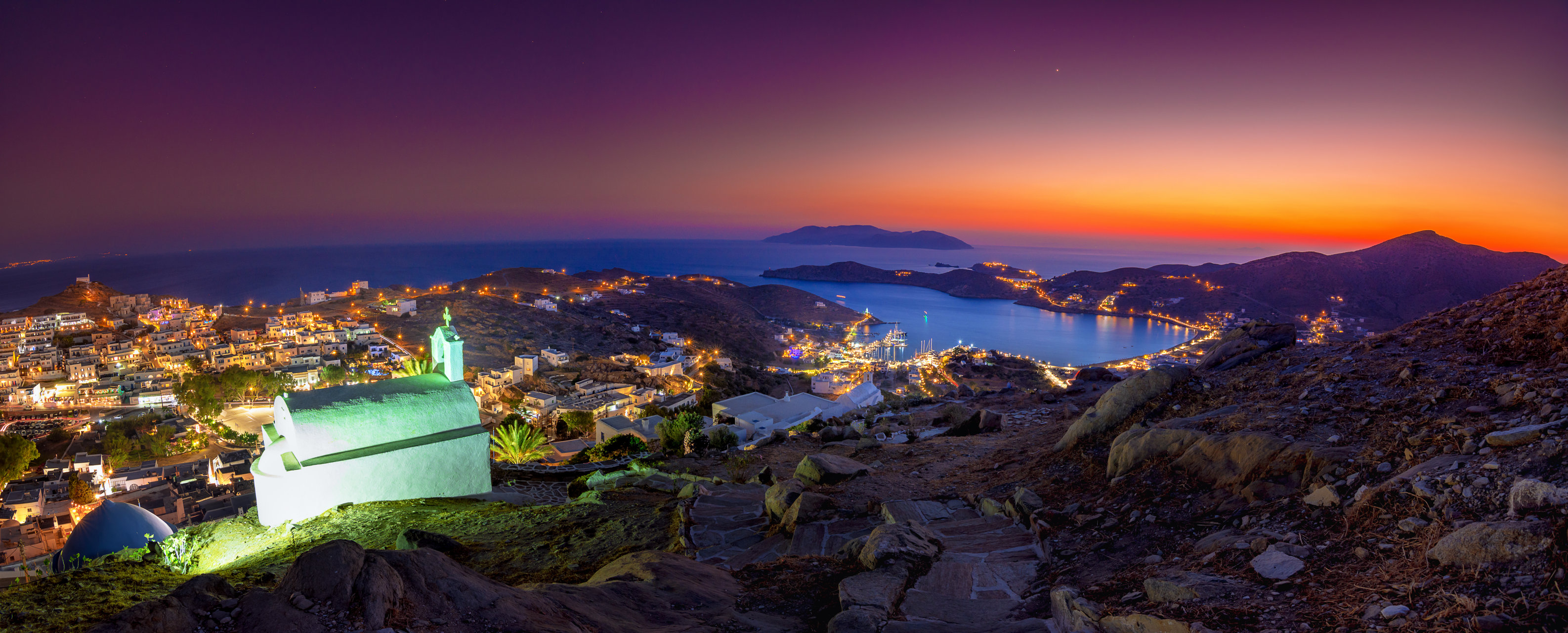 Panorama of Ios Chora and old harbor at sumset, Cyclades
