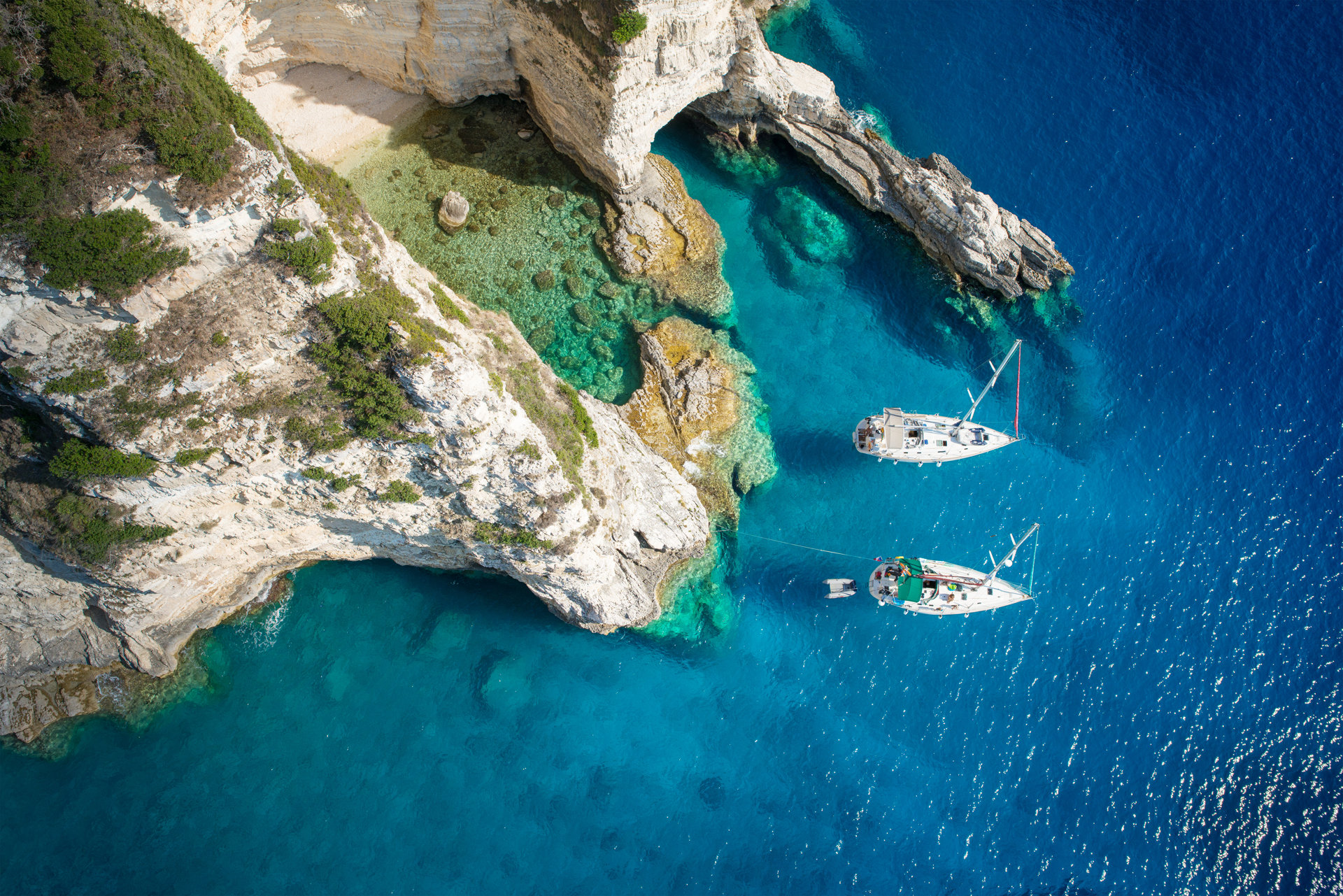 Sailboats in Paxos island
