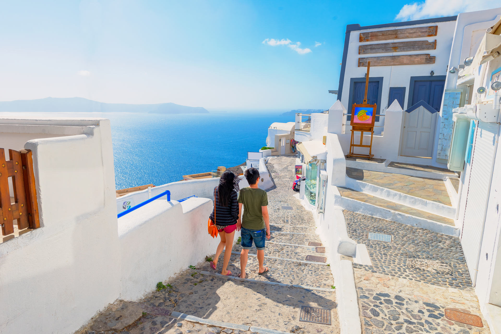 The famous island of Santorini in the Cyclades, panoramic view of traditional whitewashed houses and colorful caldera