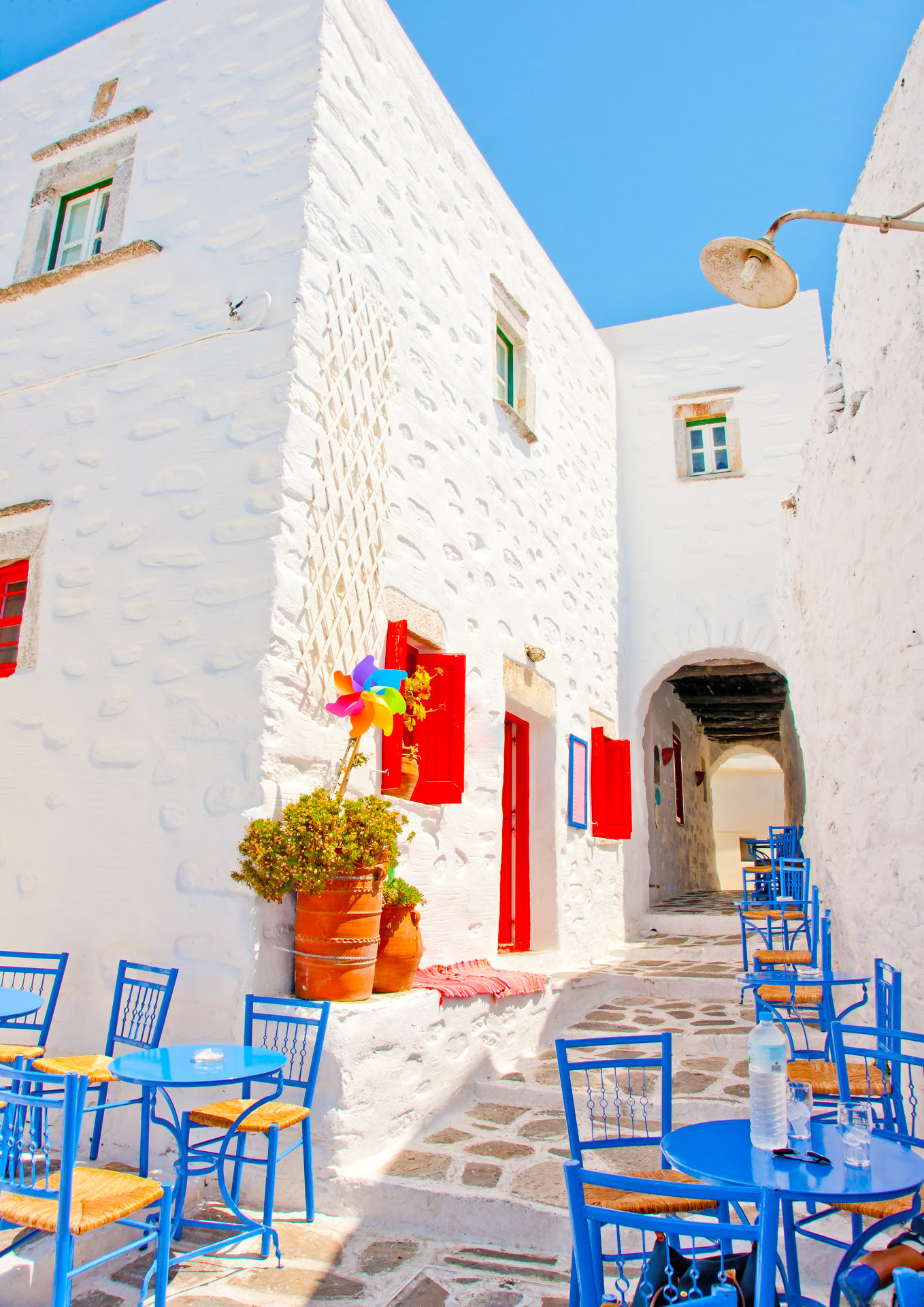 Tables and chairs in Chora the capital of Amorgos island