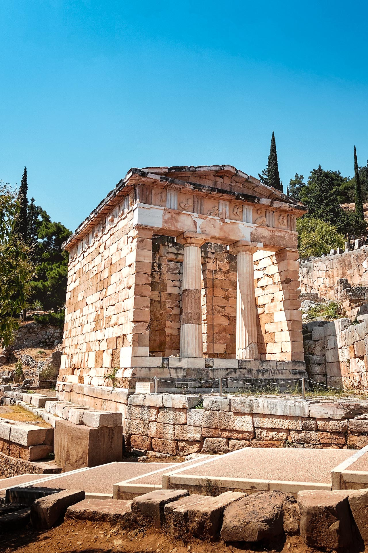 The Athenian treasury. The best preserved of the treasuries containing the monuments and gifts of victorious city states