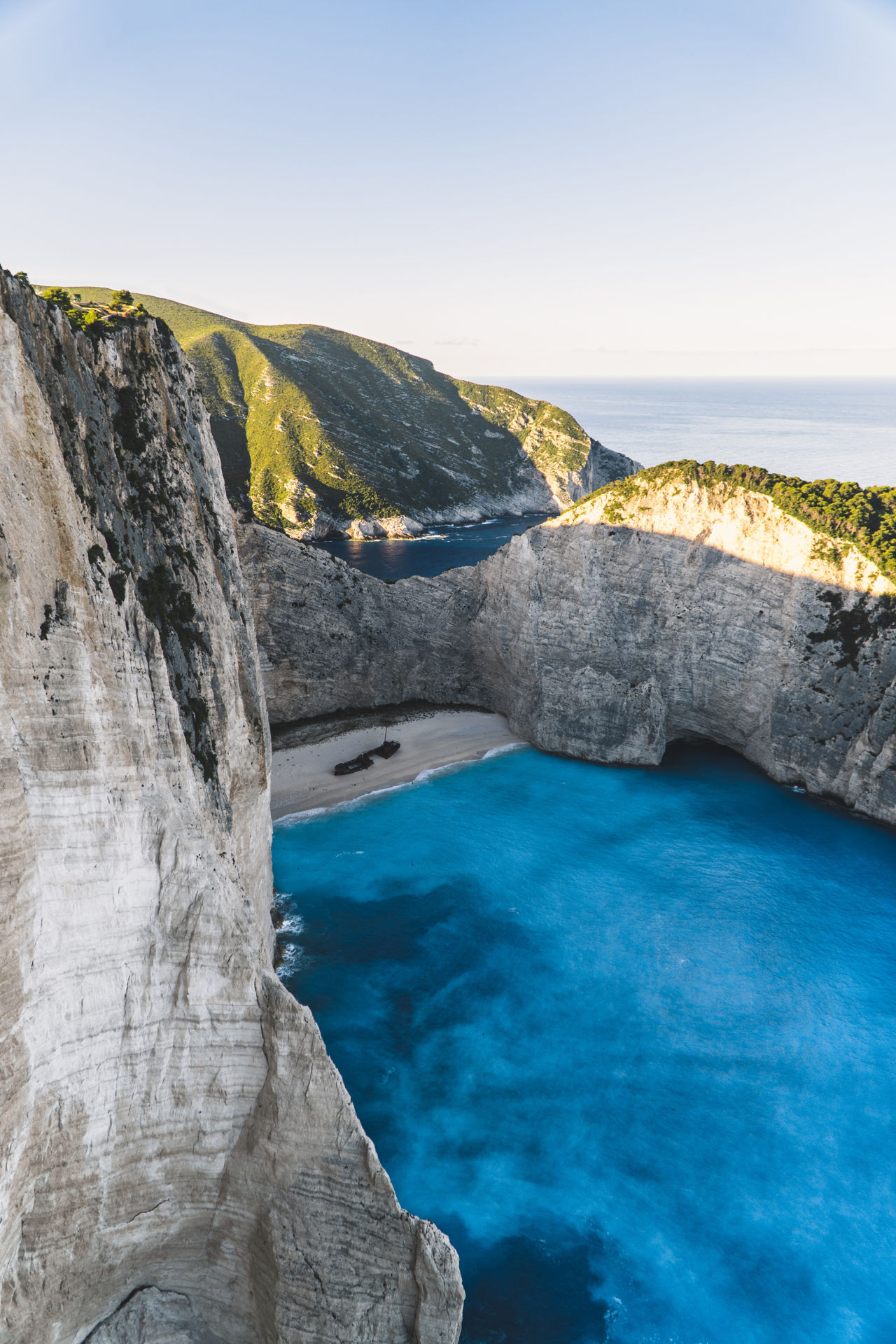 The water in Navagio often radiates impossible shades of blue