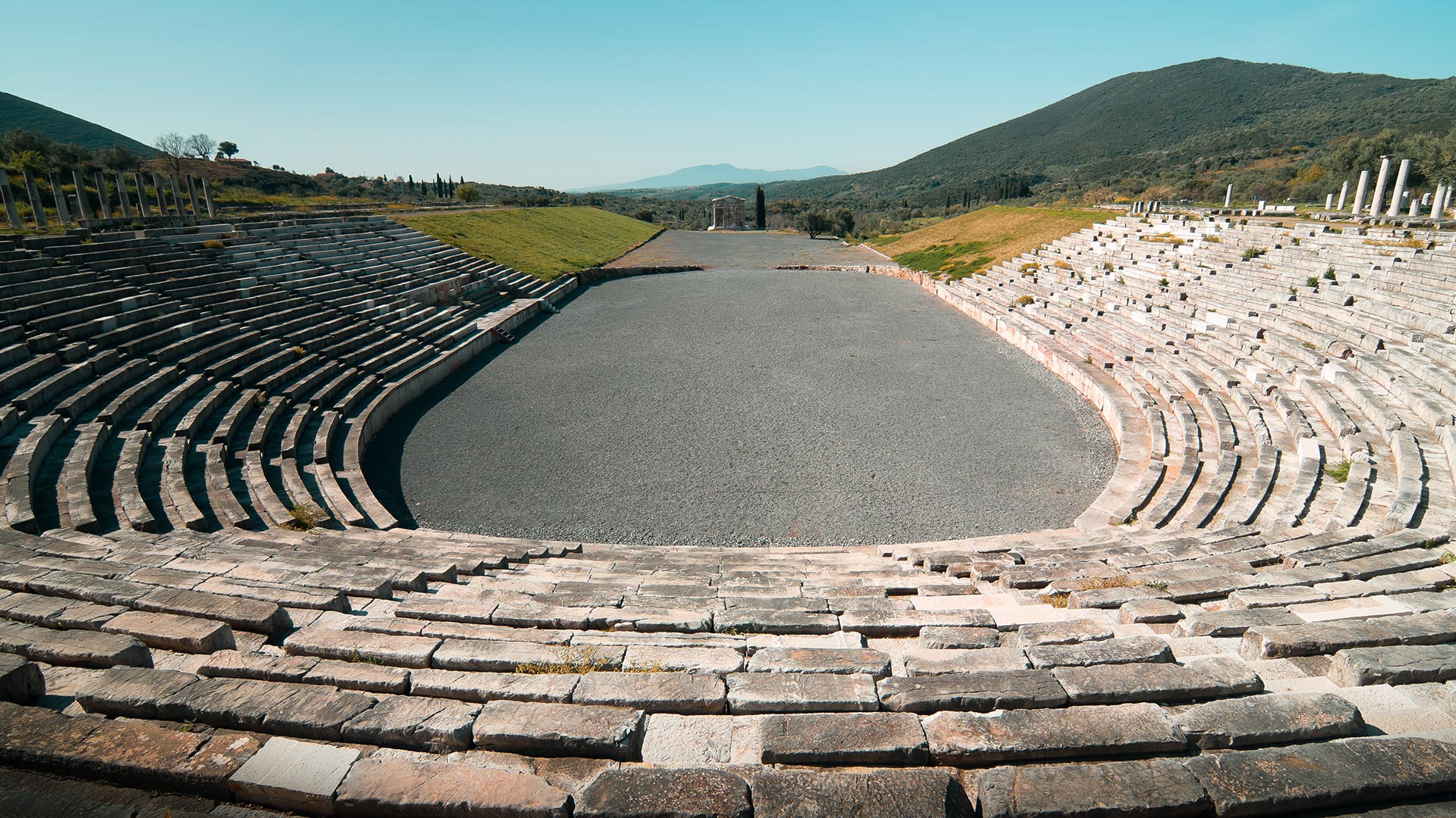 Among the most impressive buildings, the well-preserved stadium includes 18 rows of seats