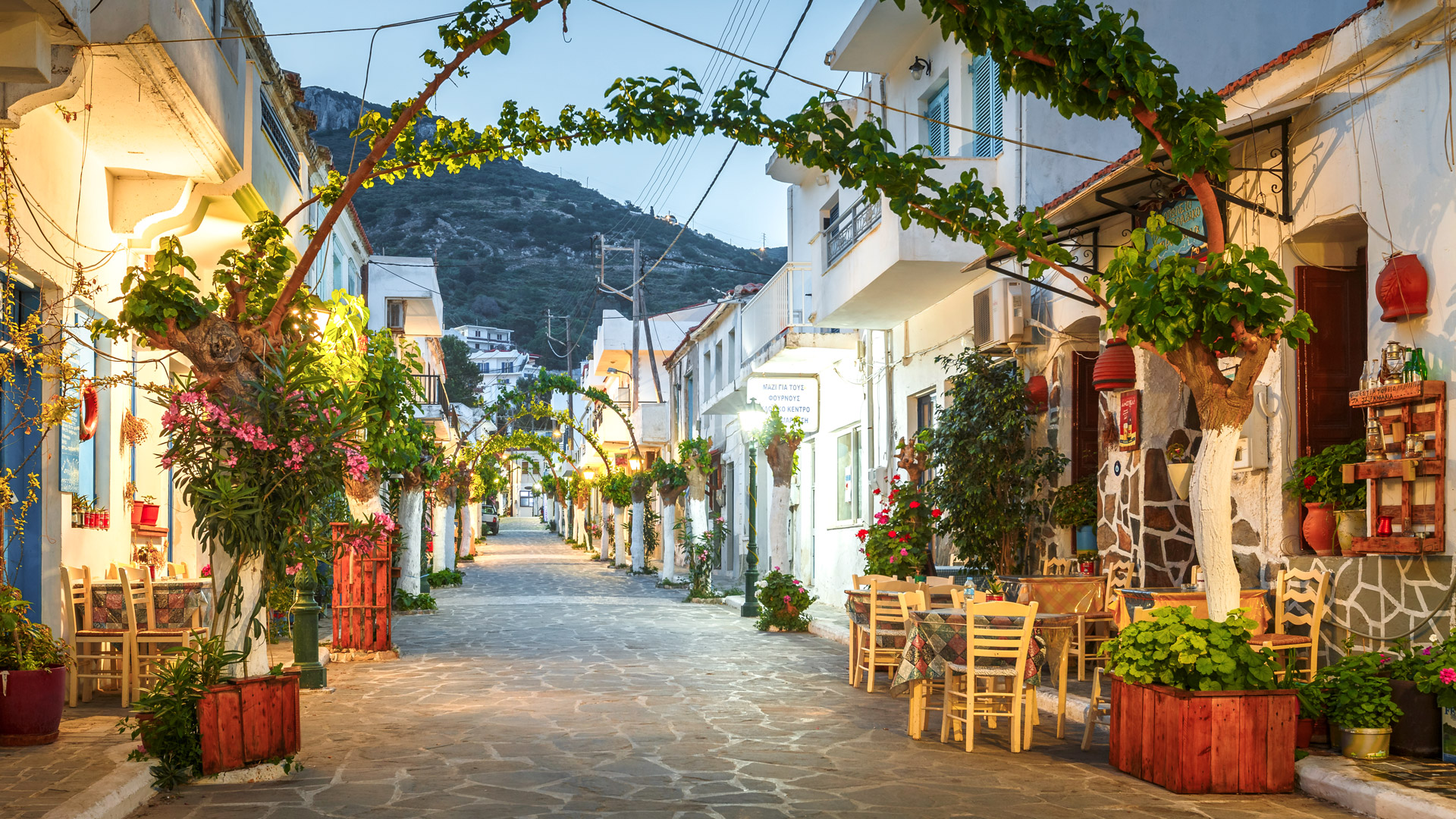 iew of the main street with shops and a restaurant in Fourni island, Ikaria