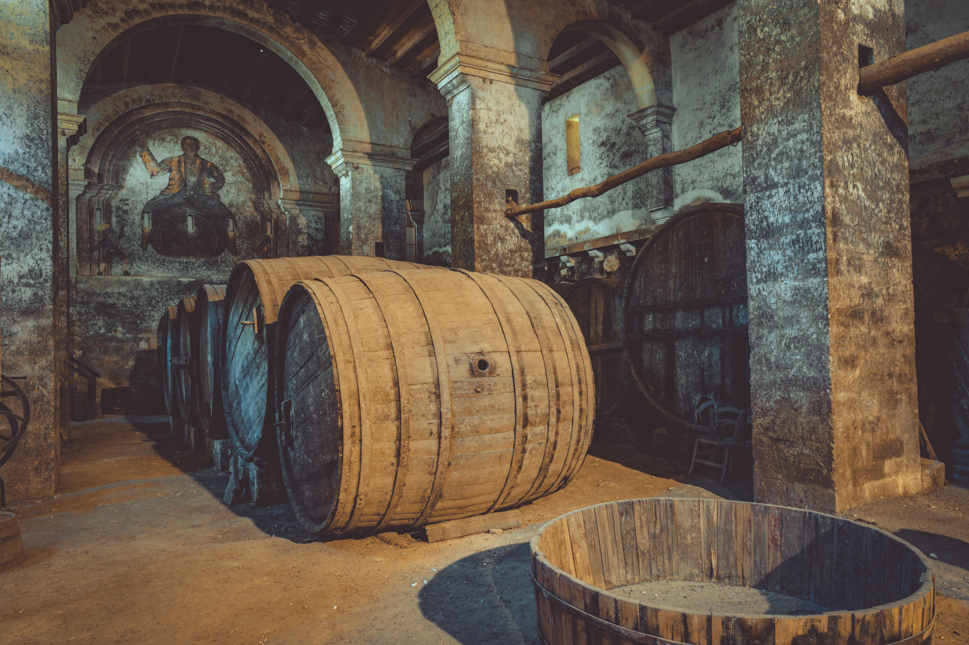 Wine barrels inside the cellar of Mylpotamos winery, Mount Athos