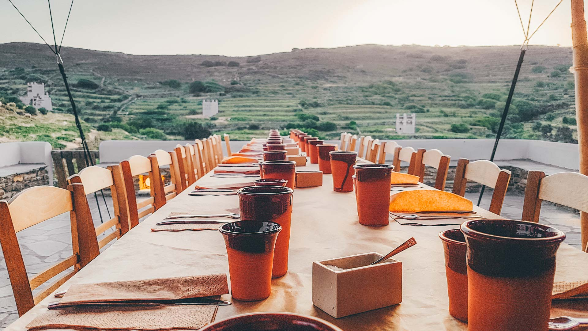 Dinner with a view of Peristerones-typical Tinian landscape and one of the most impressive works of art in the Cyclades