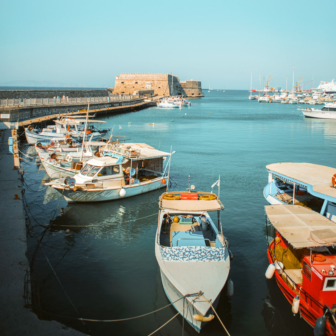 Fishing boats at Heraklion harbour and Koules Fortress