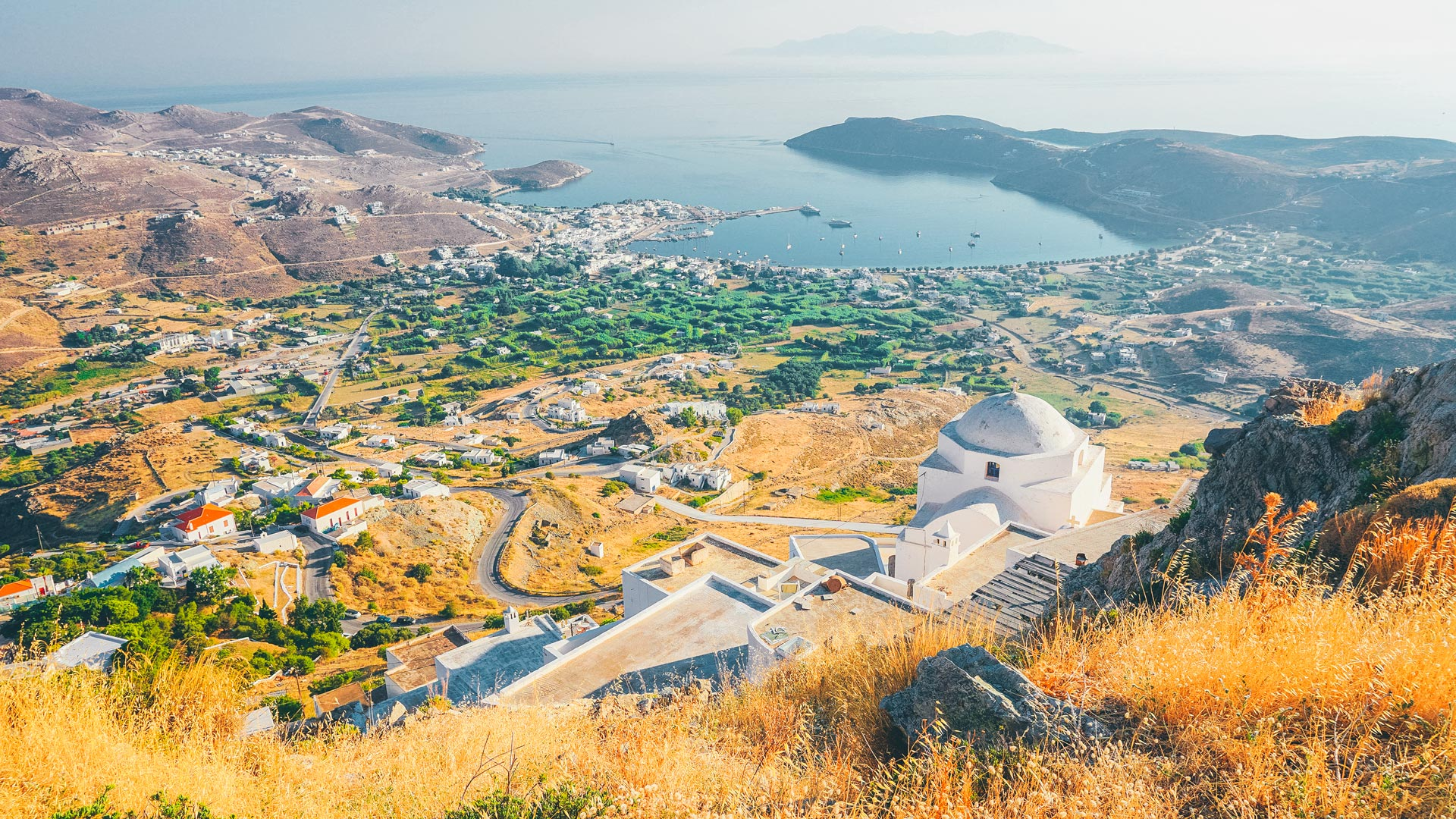 From the beautiful chapel of Agios Konstantinos nearby, you can look out beyond Livadi