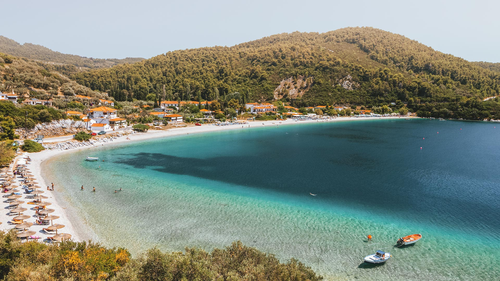 In a setting of tranquil green and blue, Panormos is one of the most welcoming beaches in Skopelos