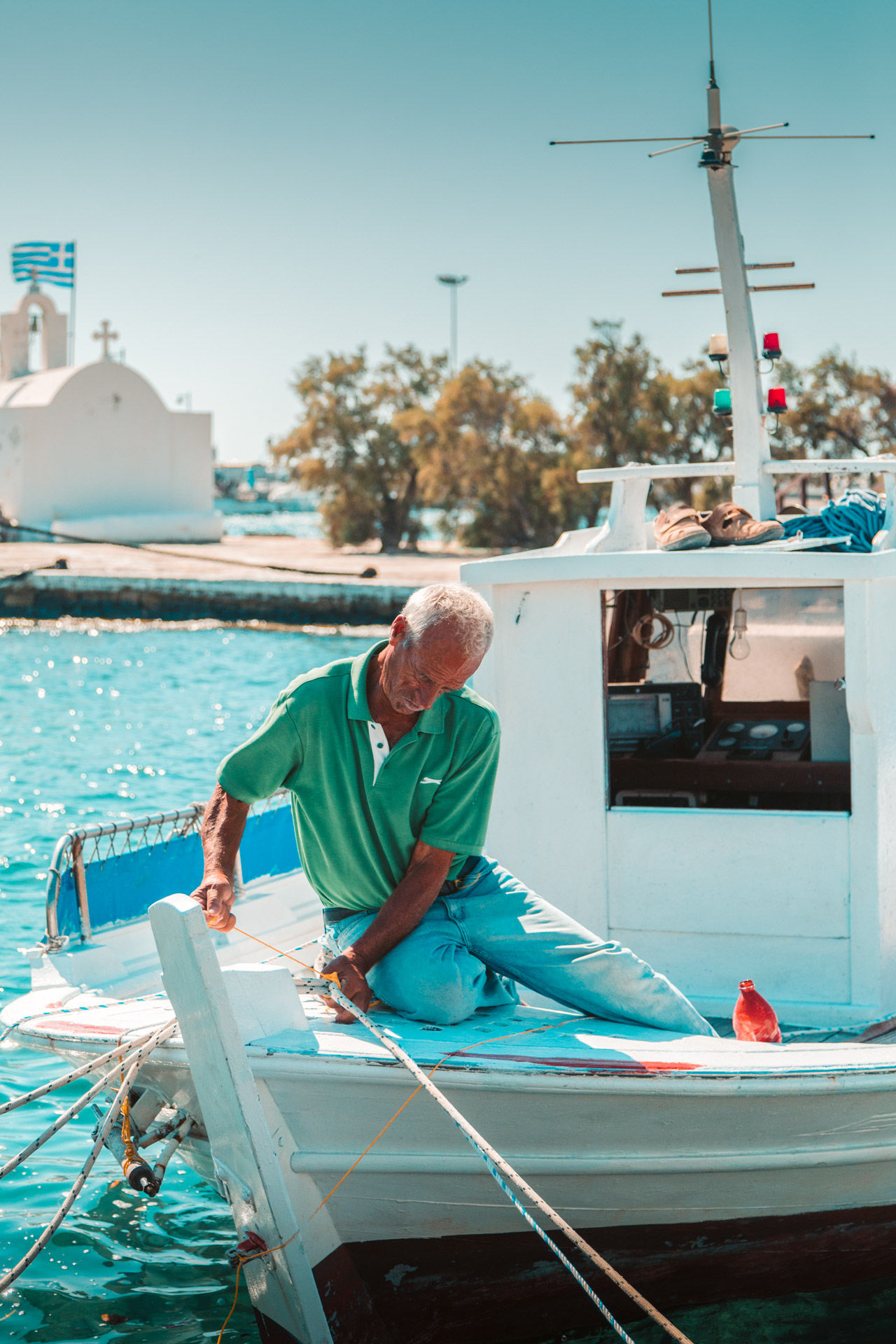 Local fisherman at the port of Naxos, doing what he knows best