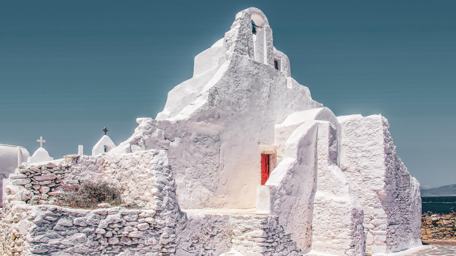 Panagia Paraportiani, sculpted into the rock and painted the most radiant white