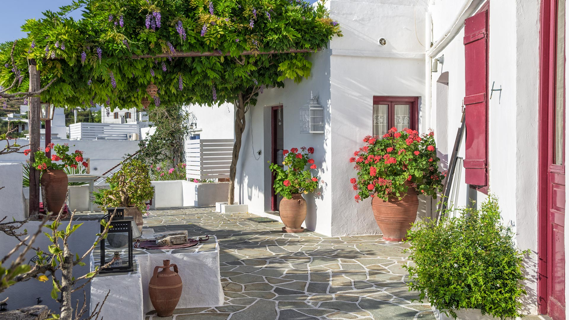 Whether it's the little whitewashed alleyways or the coloured doors and window frames, Apollonia will capture your heart