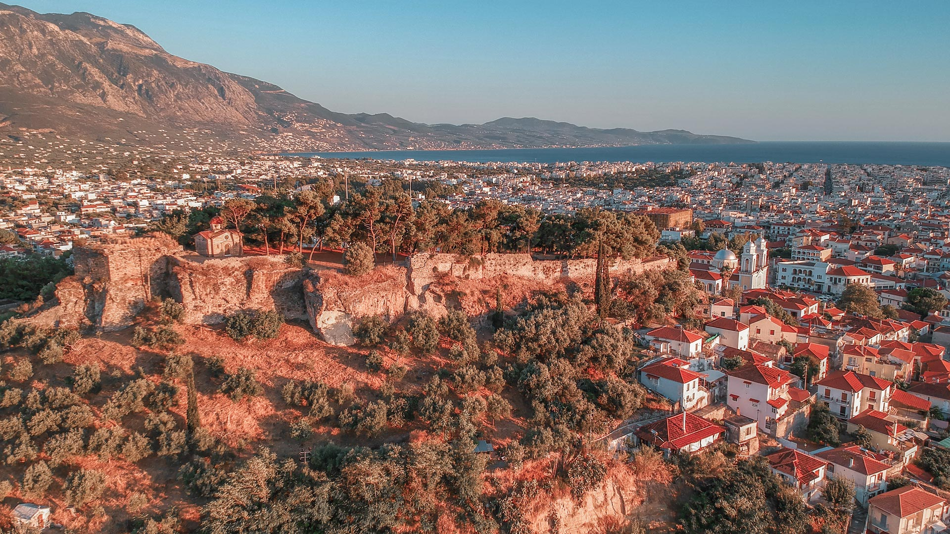 Aerial view of the wonderful old town of Kalamata City and the historical Castle at Sunset