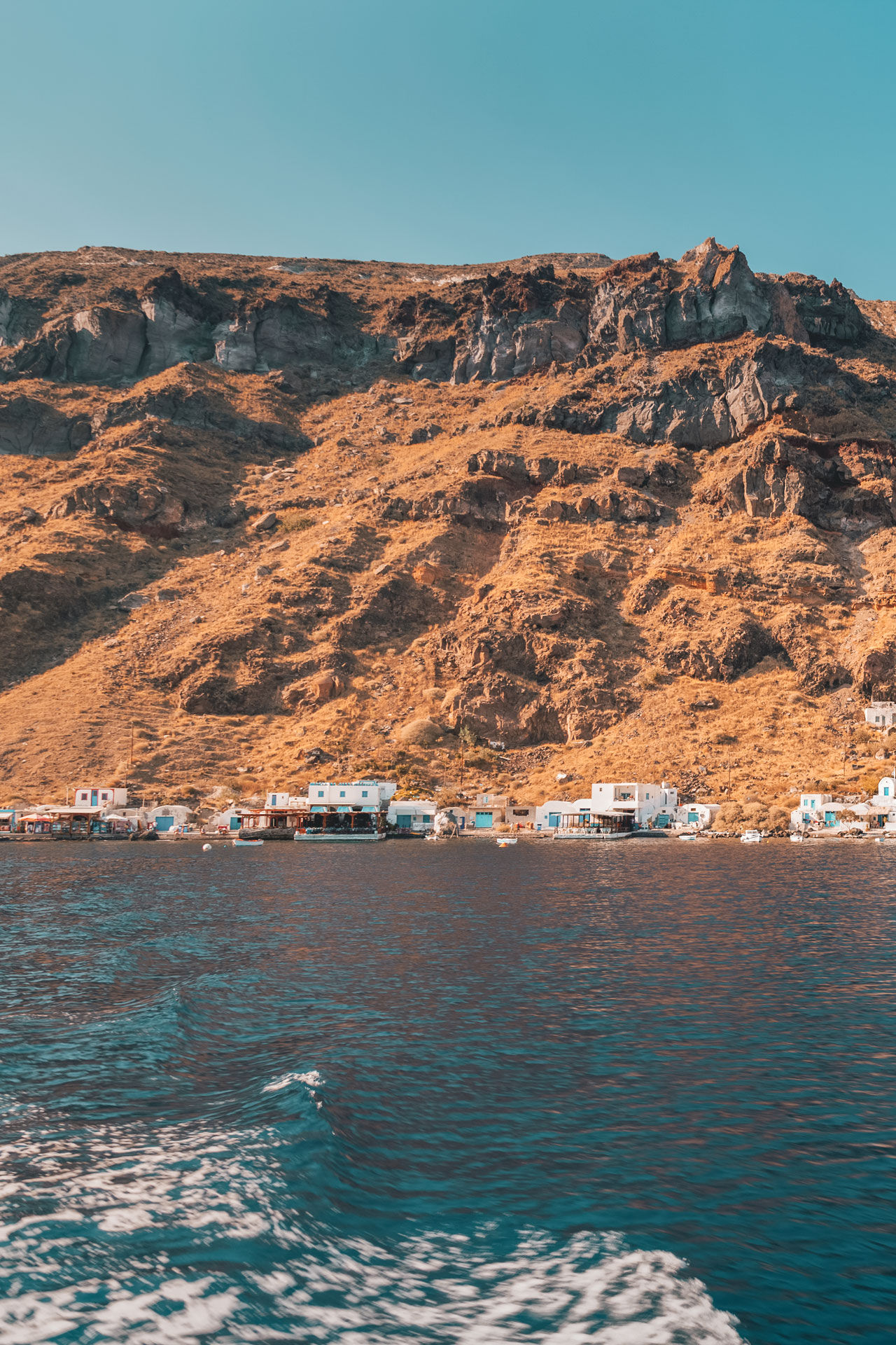 View from a boat to the harbor Ormos Korfou in Thirassia, Santorini
