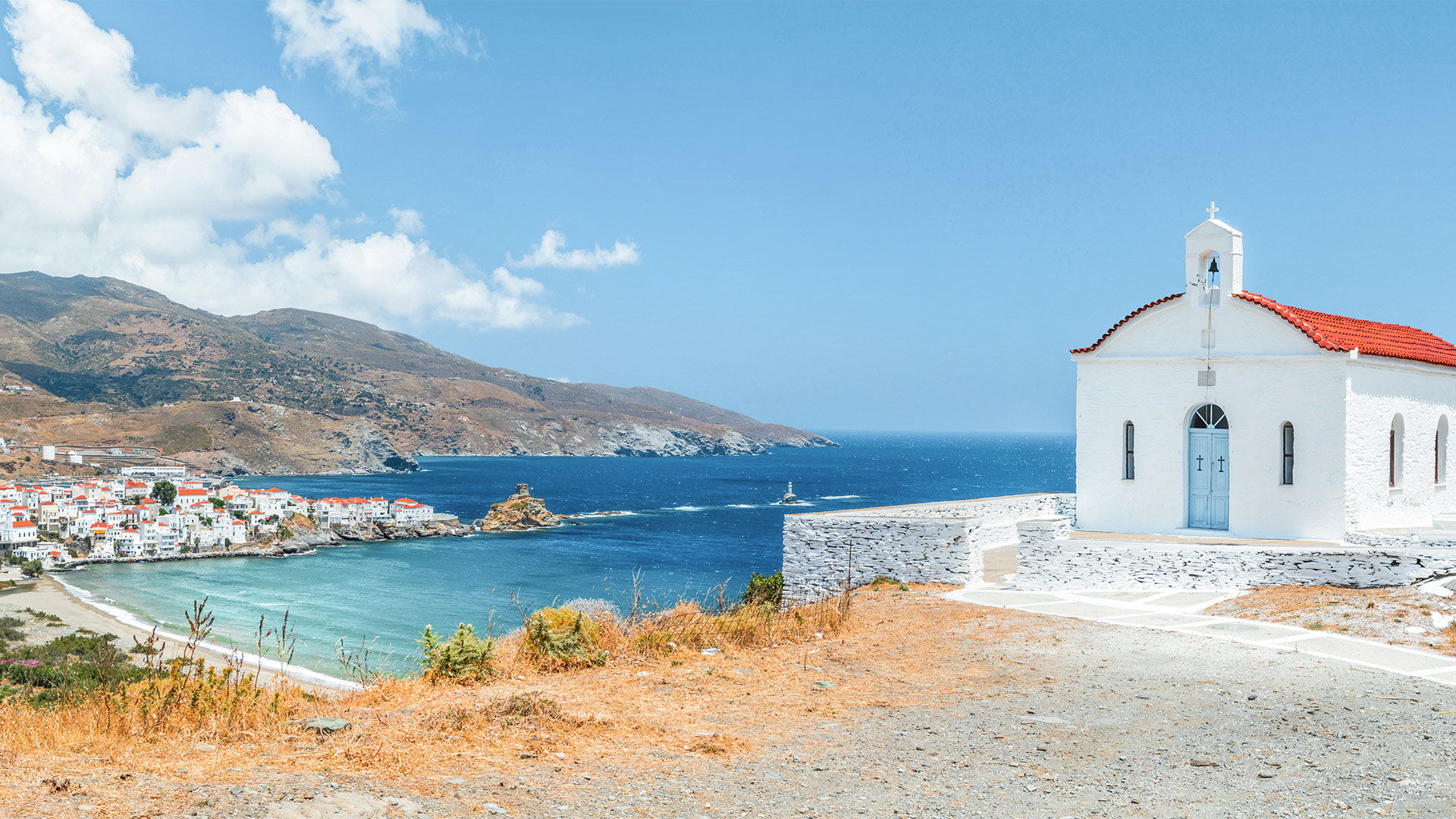 Panoramic view with small church on Andros island