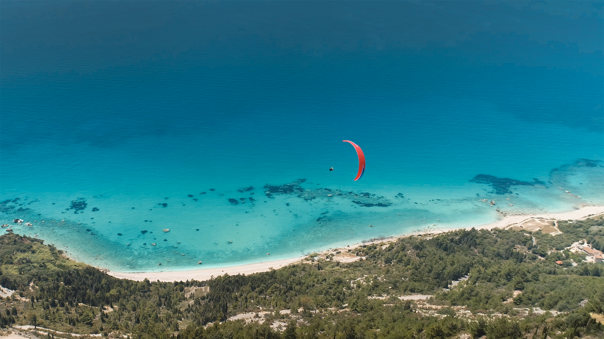 As you laze on the beach, paragliders will occasionally drift overhead