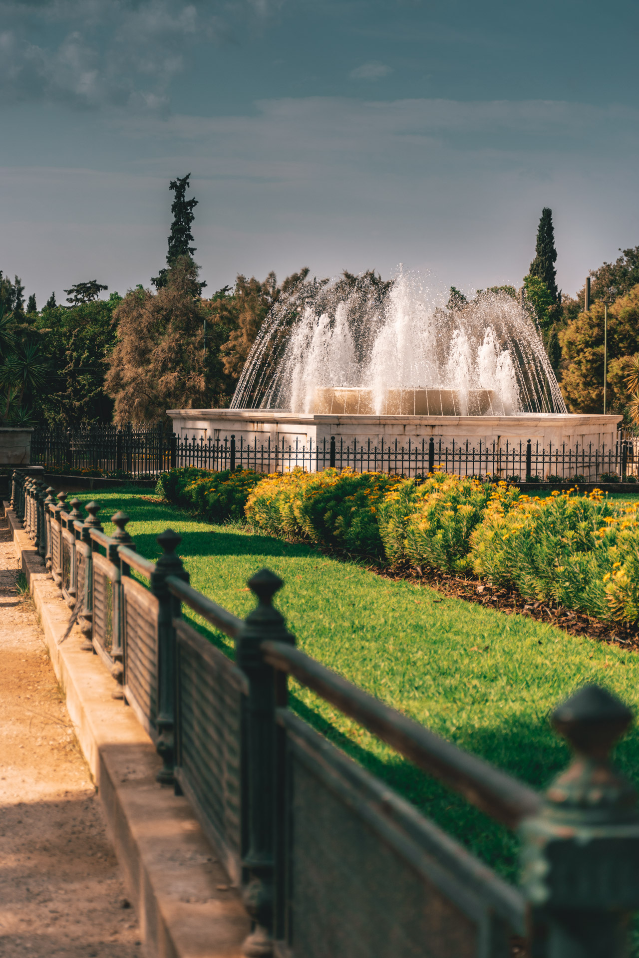 Stroll around the gardens around Zappeion Hall