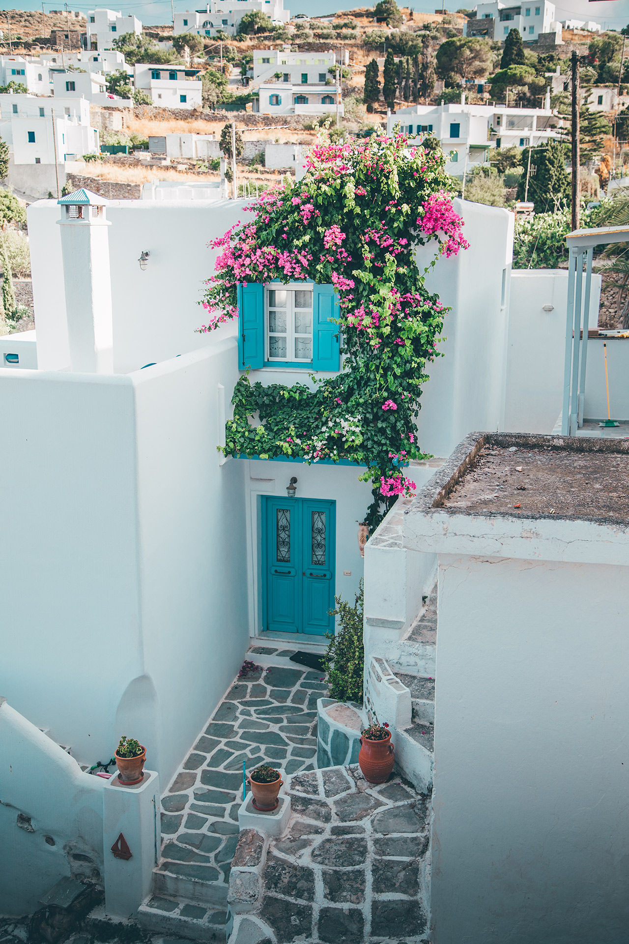 In Lefkes vilage you will find whitewashed houses, blue doors, bougainvillea and windmills