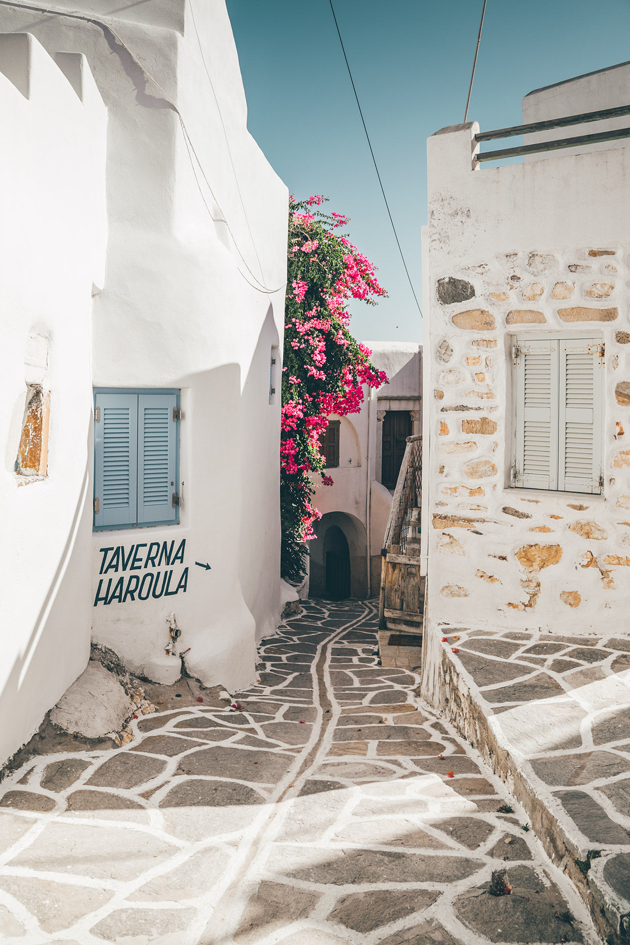 The Cycladic theme of sugar-cube houses, flowers and tiny churches continues in the villages of Paros