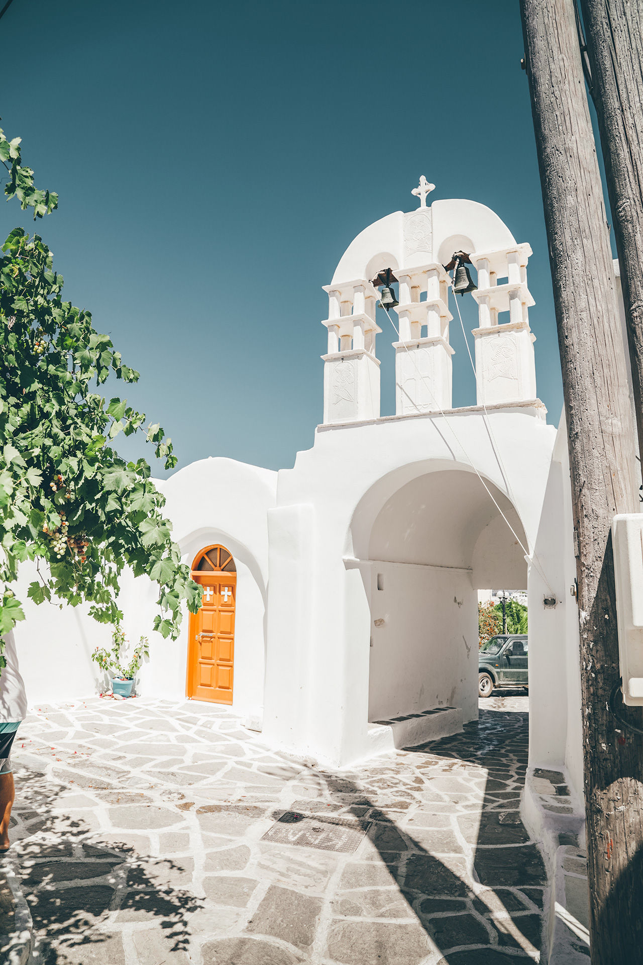 View of church and cycladic alleyway in Prodromos village