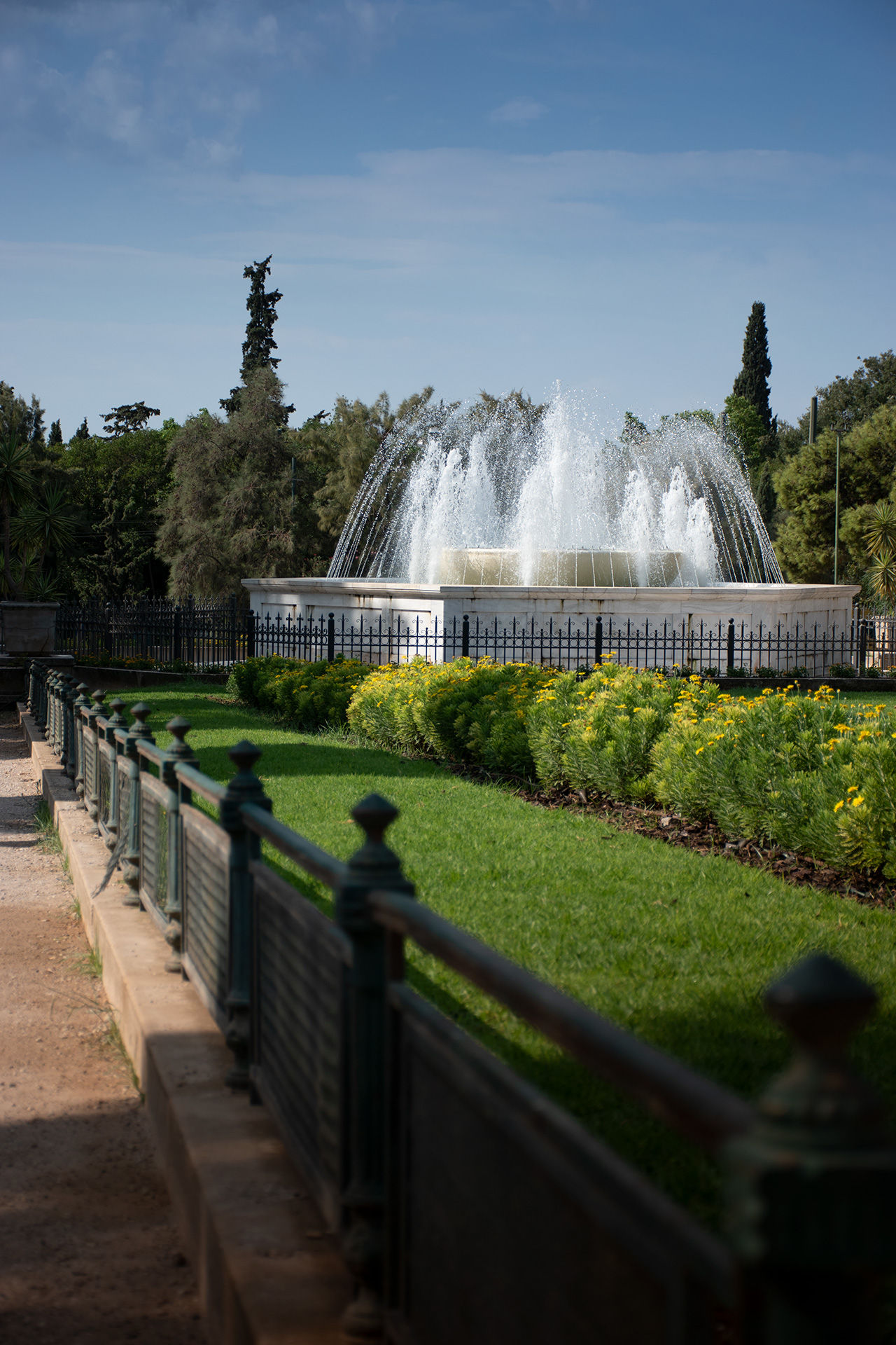 View of fountain and greenery in Zappeion park