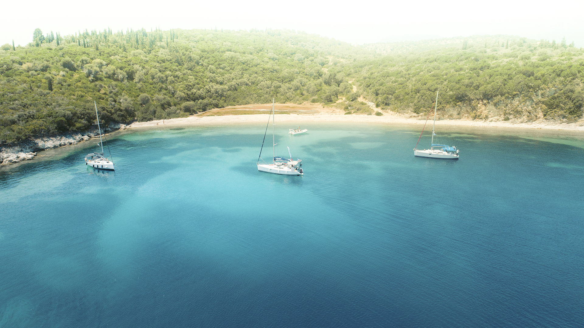 By hiring a sailing boat and skipper, you can set sail from Nydri and explore all those gorgeous beaches