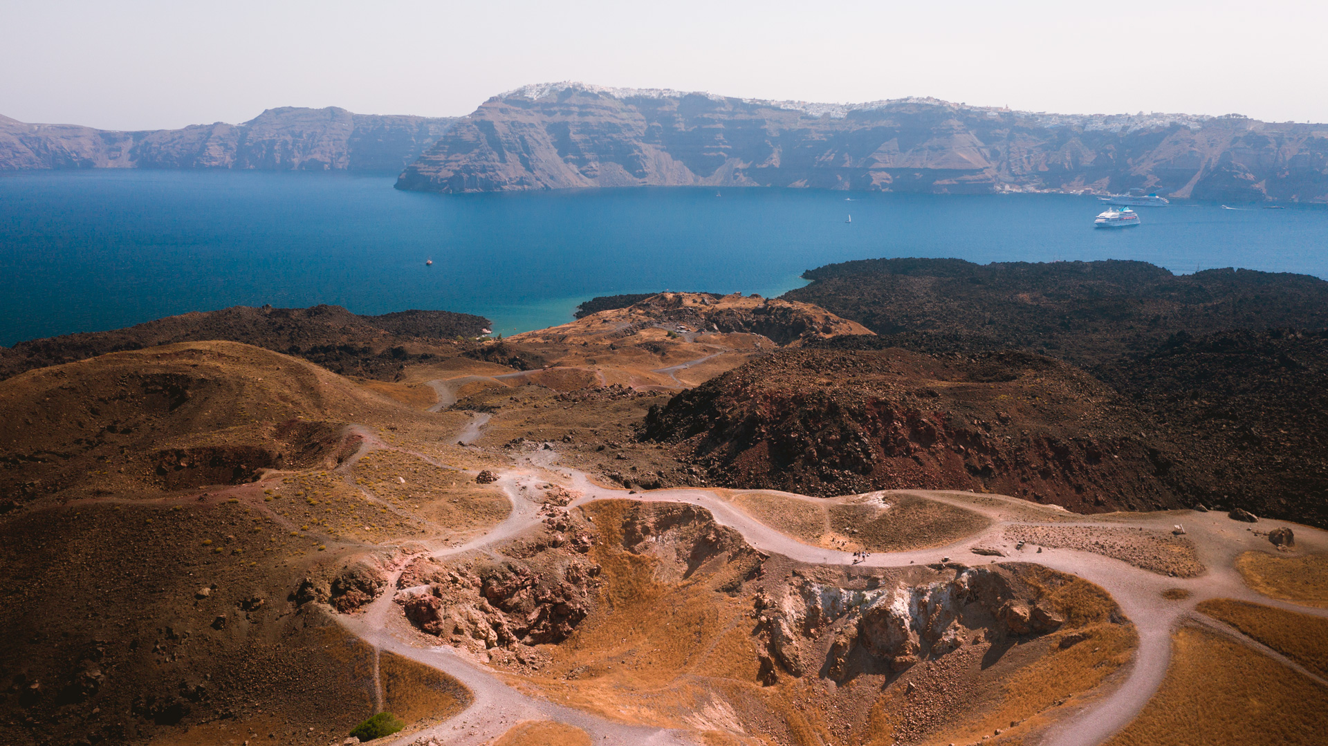 On barren Nea Kameni, it's a 30min hike across black and red petrified lava to the crater of the famous volcano