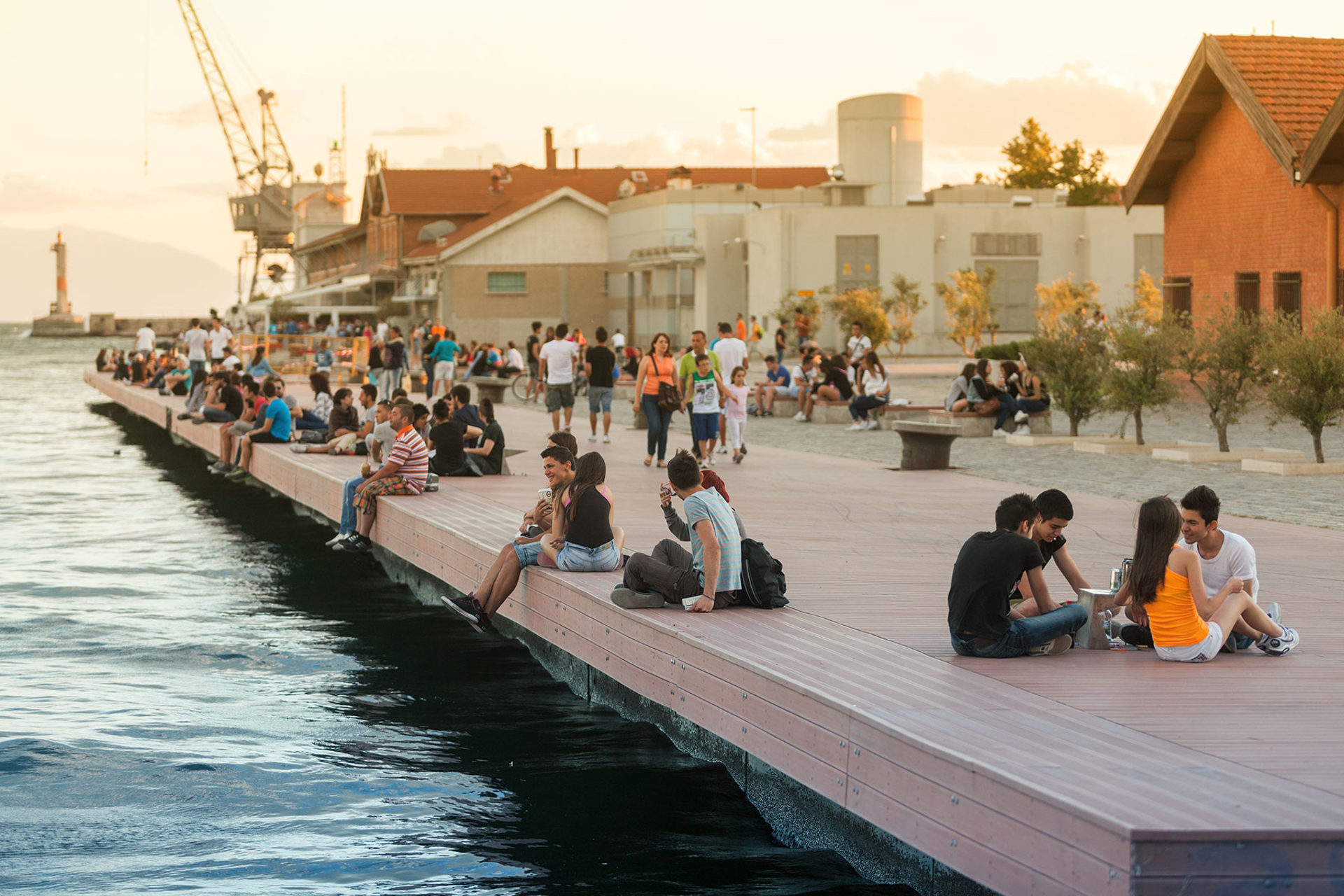 Young people relaxing and talking at the Thessaloniki beach