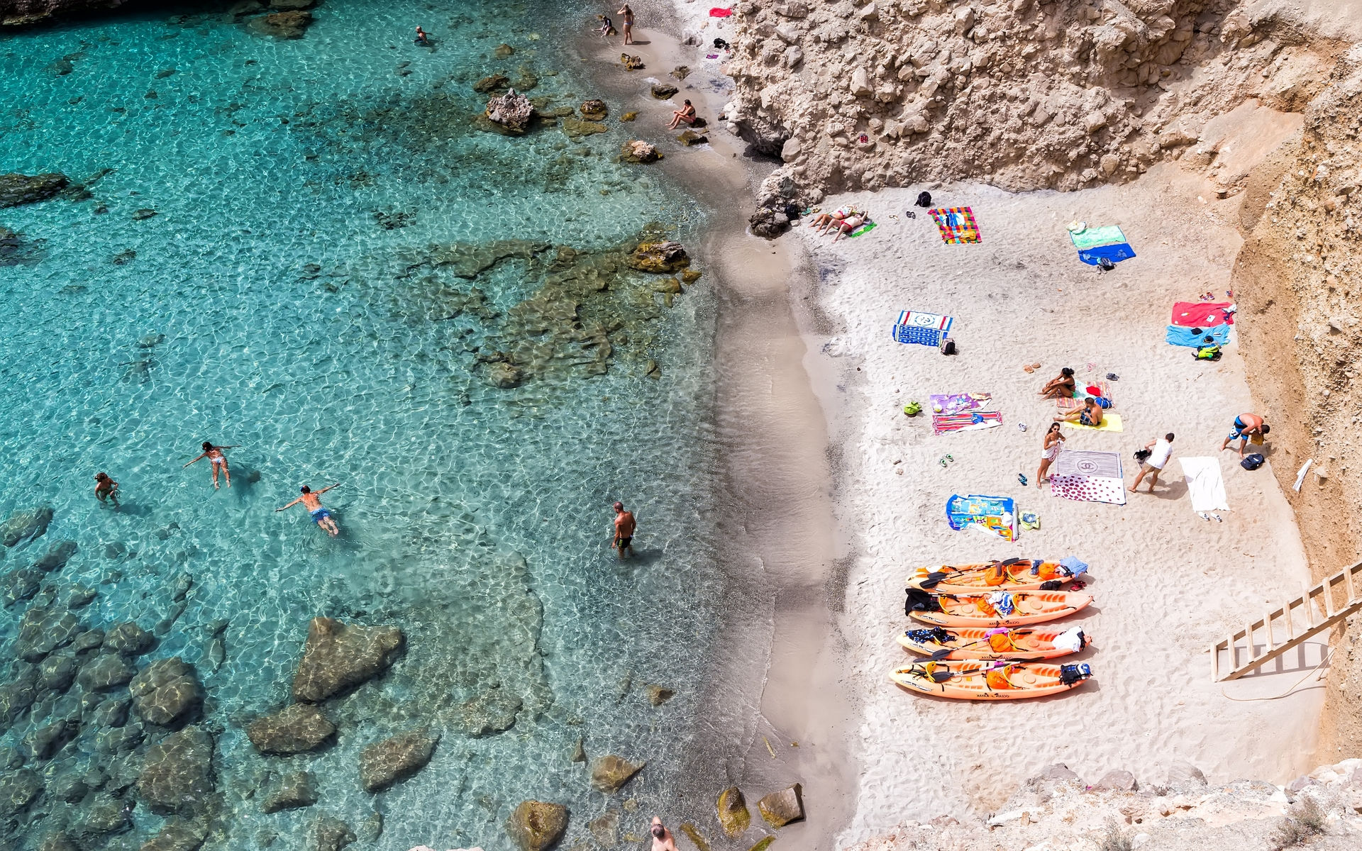 Canoes at tsigrado beach in milos island
