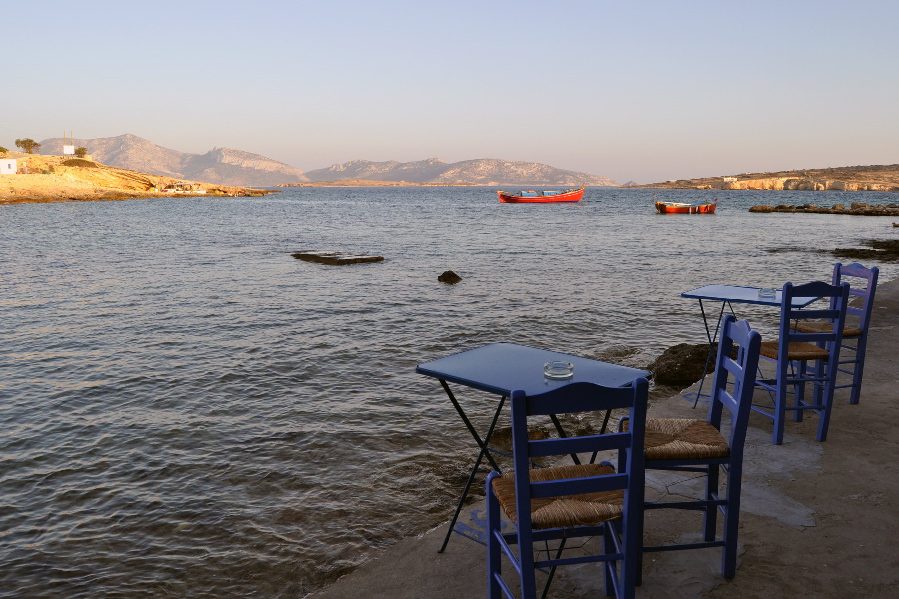 Blue chairs and a sunset in Koufonisia