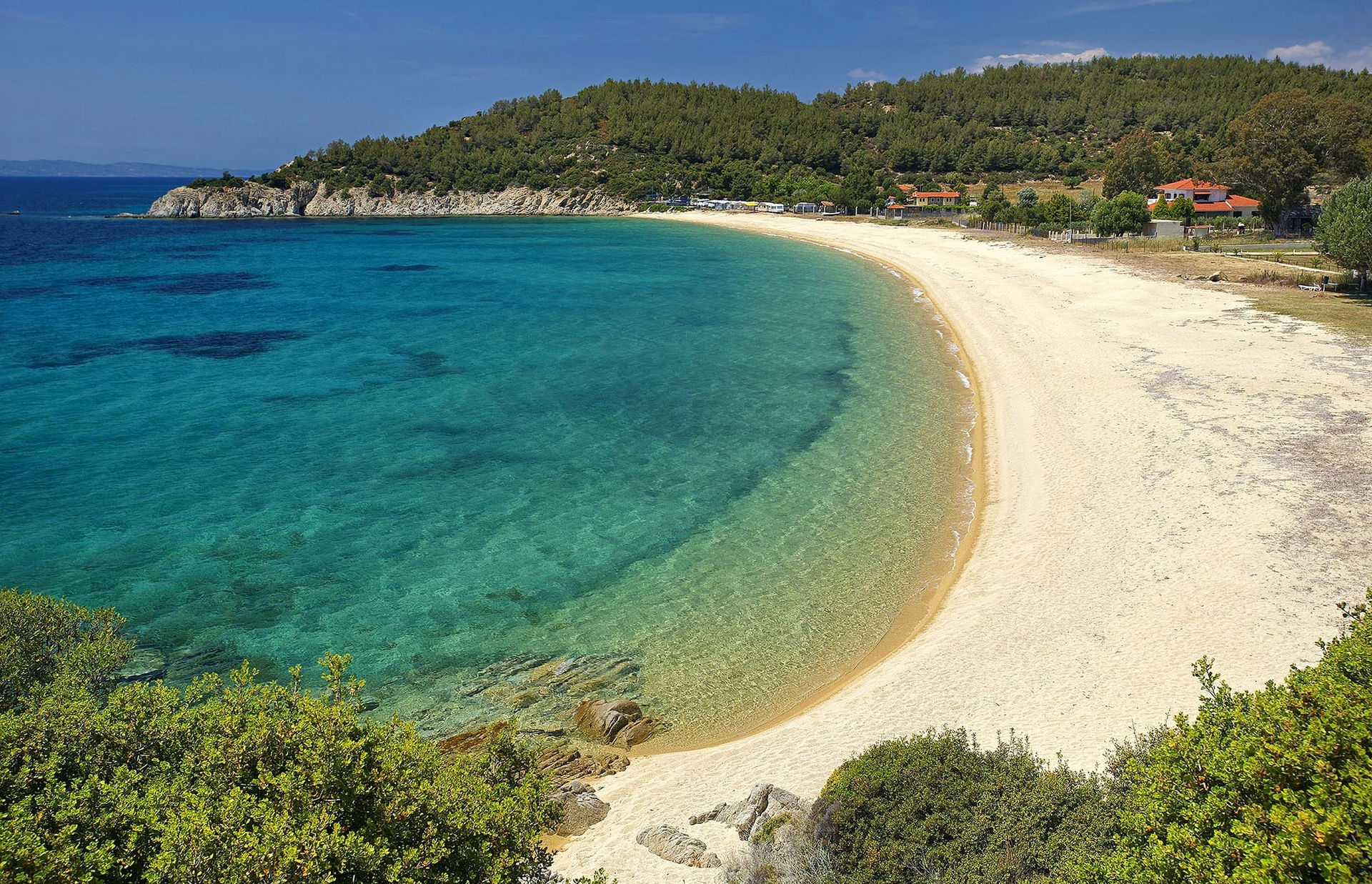 Crystal-clear turquoise waters, on a heavenly Halkidiki beach