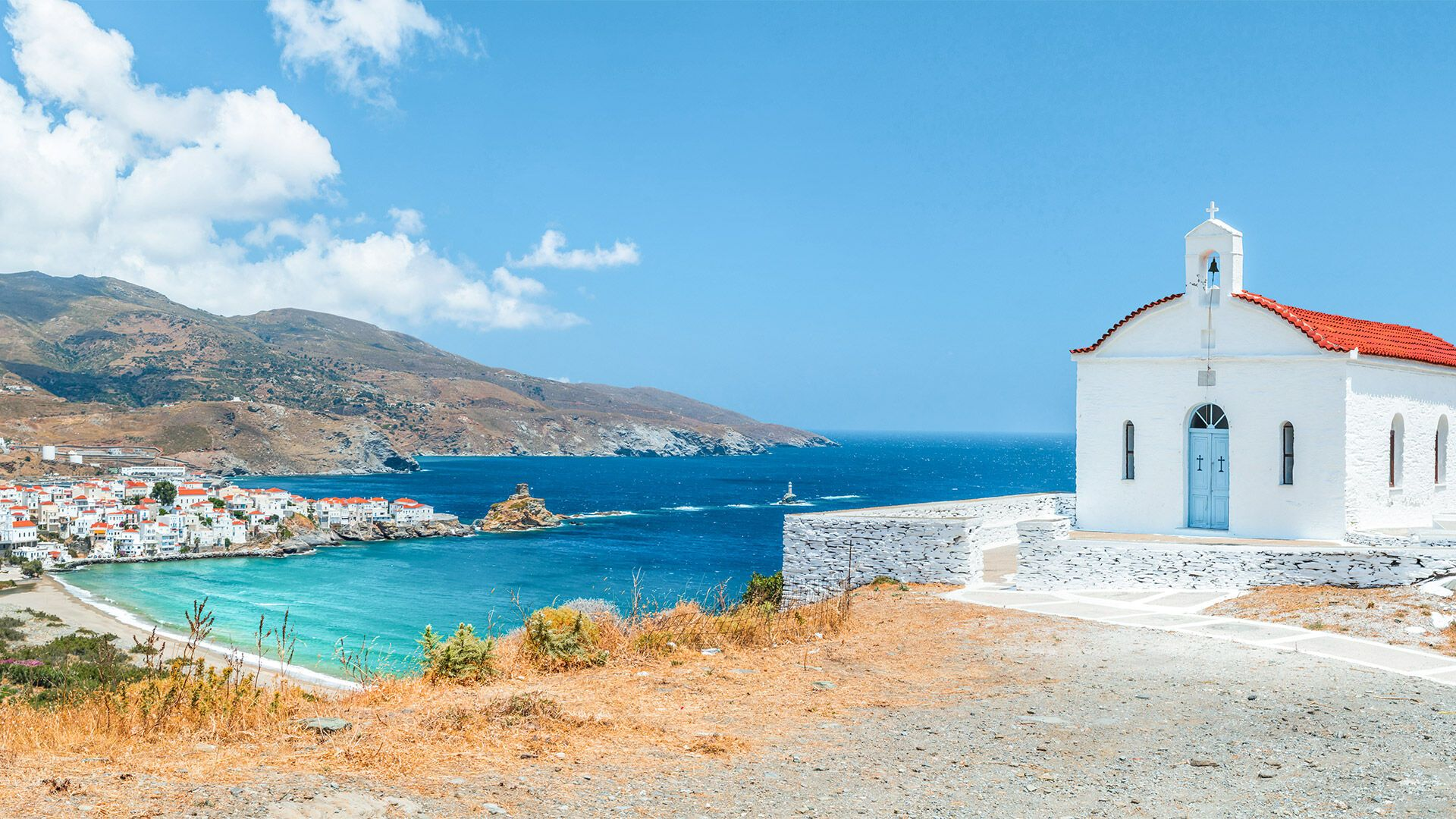 Panoramic view with small church, Andros island