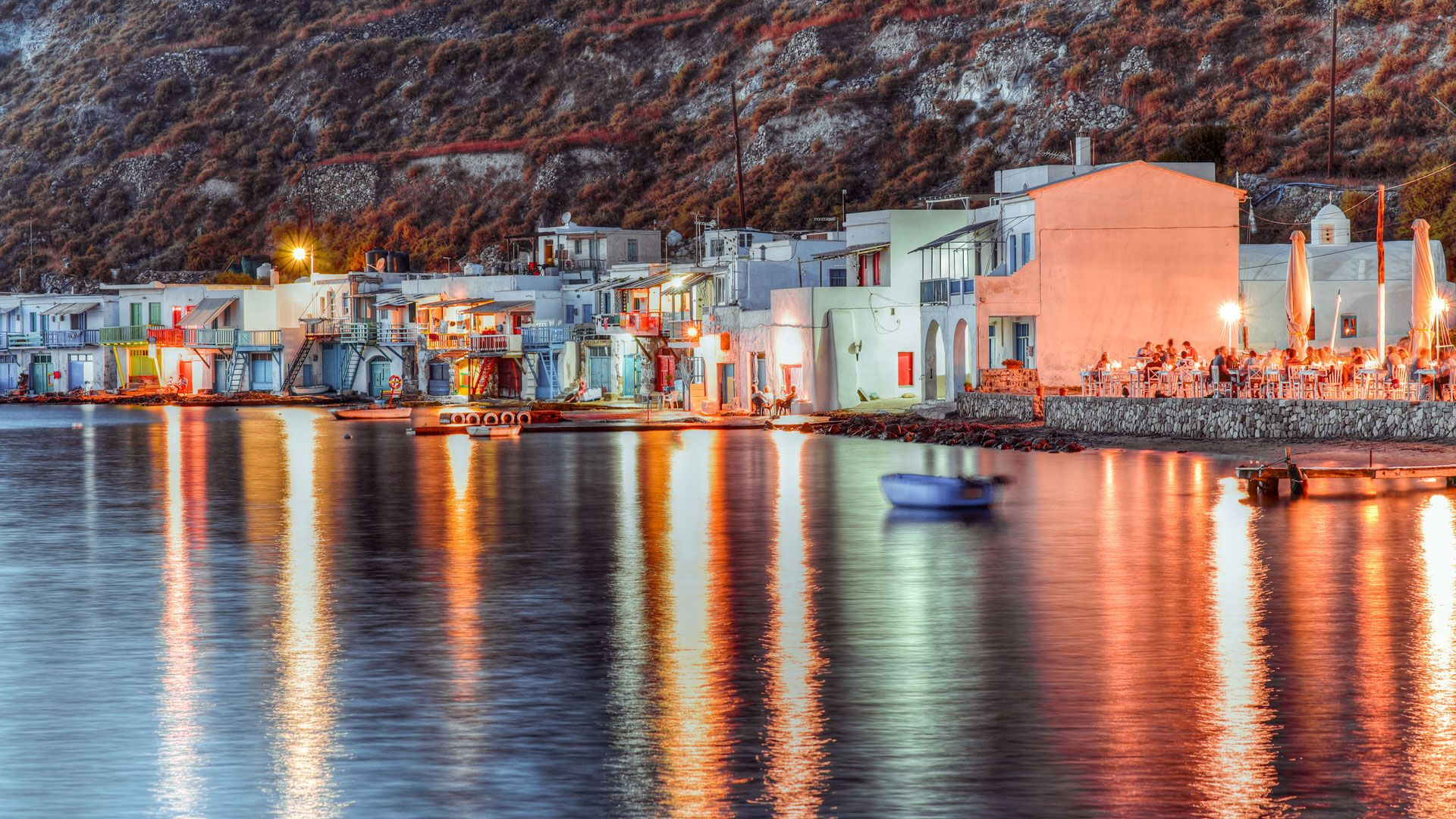 Colourful fishermen's boat houses at night, Klima village, Milos
