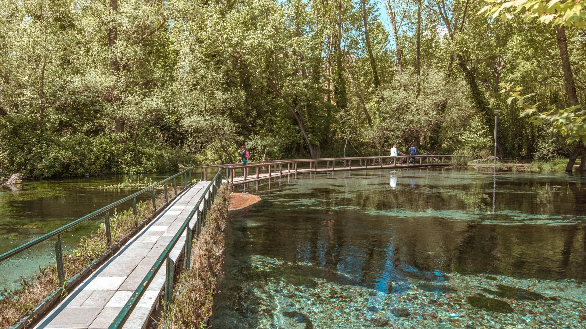 In Agia Varvara park, bubbling springs flow into canals and ponds, watering ancient trees and reminding you of nature's pure beauty