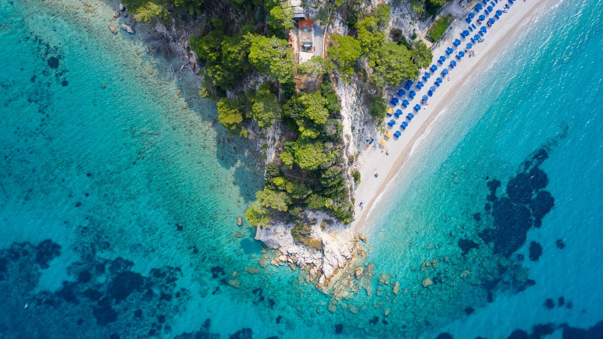 On the north coast, you could start with popular Kokkari beach
