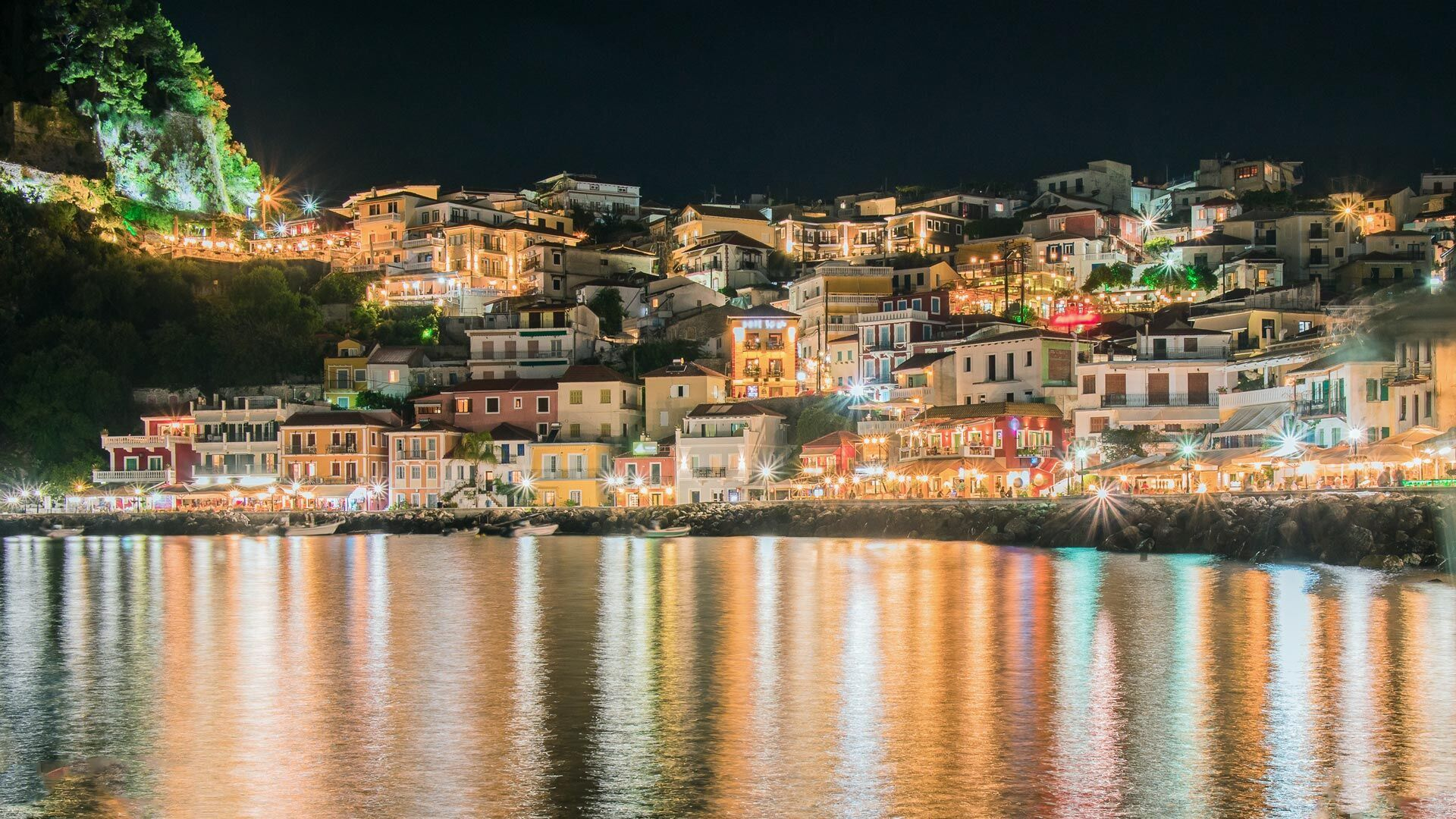 Looking across the bay towards traditional houses and Parga's castle, during the night