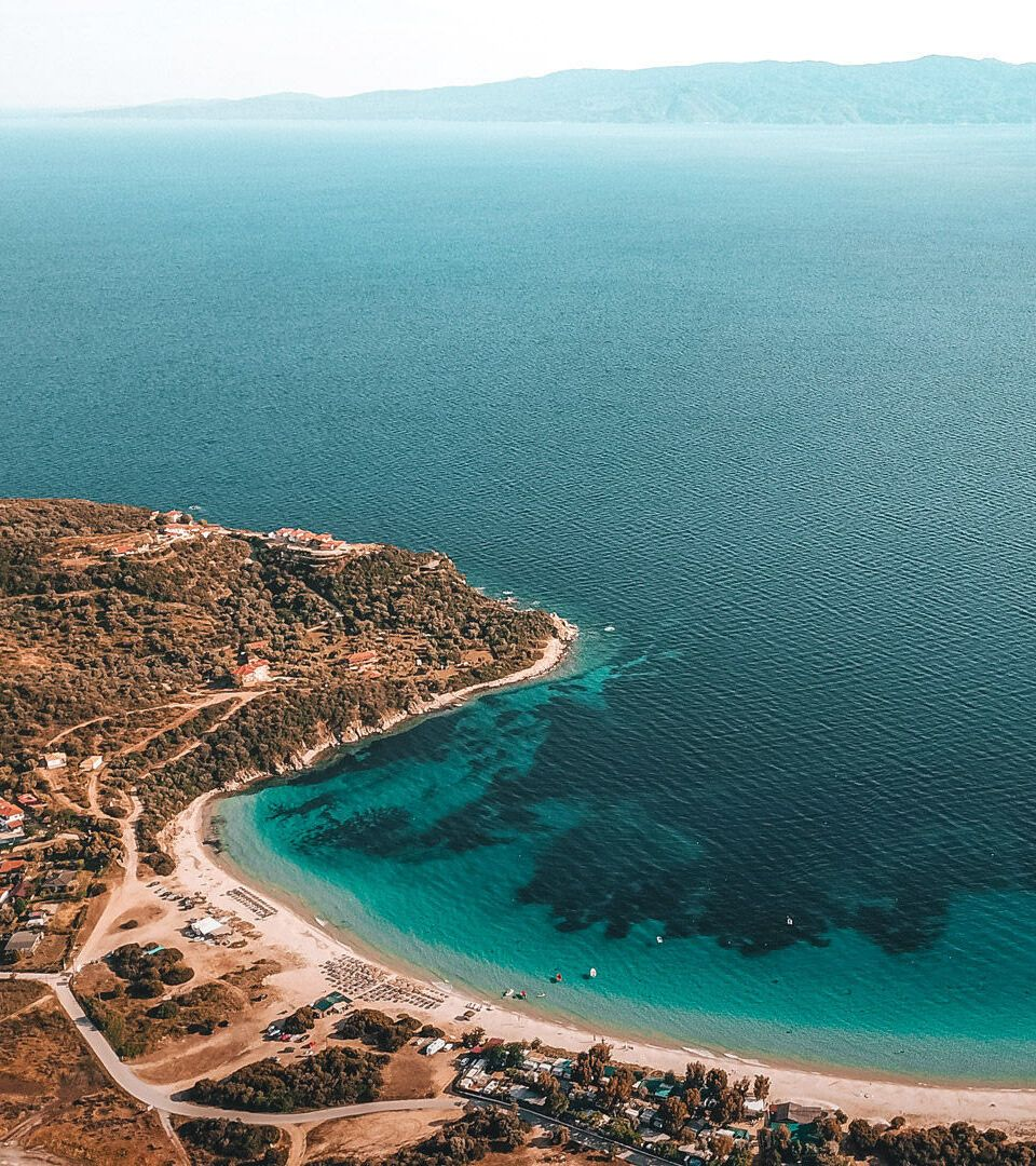 Alikes,-one-of-most-beautiful-and-popular-beaches-on-the-island,-looking-onto-the-Sithonia-peninsula-DJI_0190_Αμμουλιανή-Δρένια