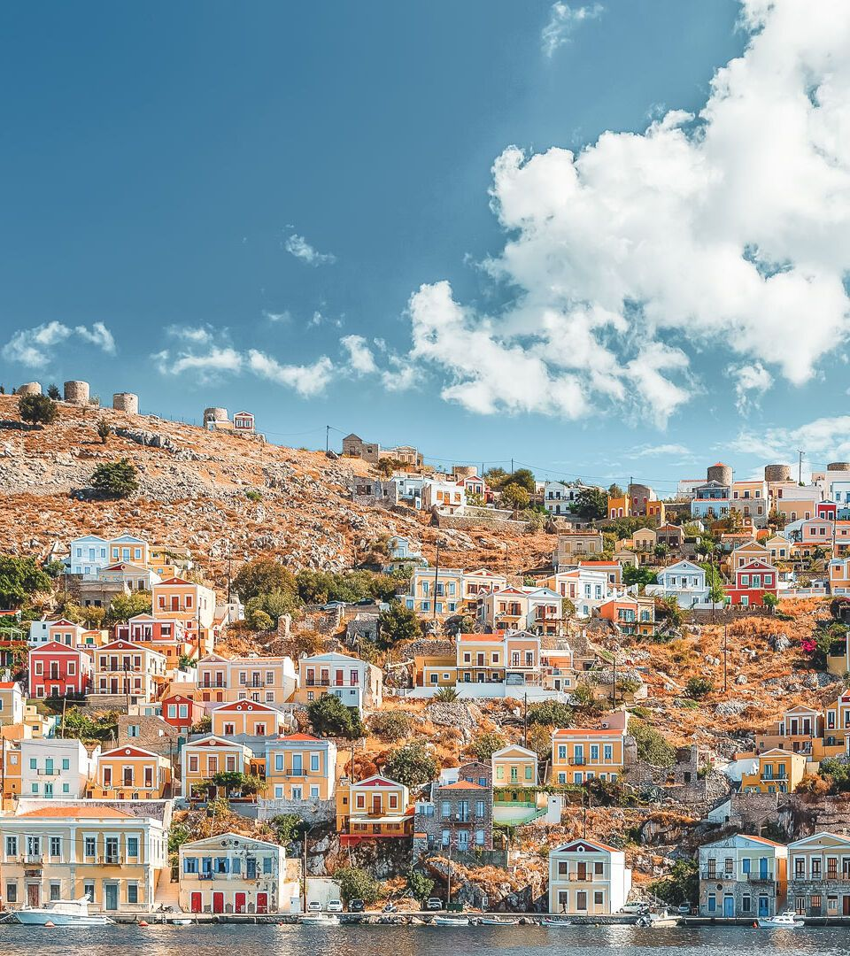 https://www.discovergreece.com/sites/default/files/styles/hd_half/public/2019-12/1_beautiful_summers_day_on_the_greek_island_of_symi_in_the_dodecanese-1.jpg?itok=a97fo76C
