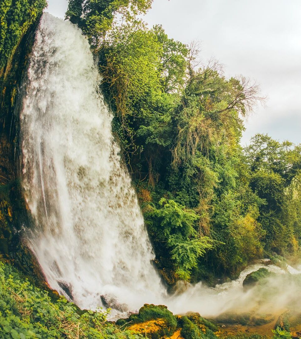 Famous Keranos waterfall drops 70m among plane trees that were seeded centuries hence
