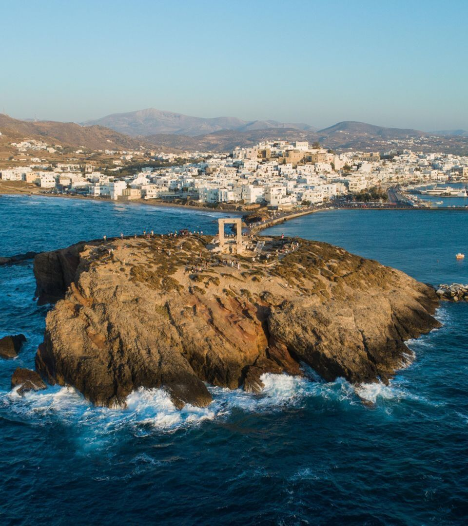 View of Naxos Hora from the little island on which Portara stands, Palatia, is now connected to the mainland