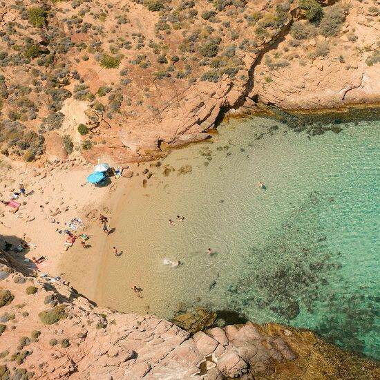 Secluded beach beside Agios Sostis beach in Mykonos
