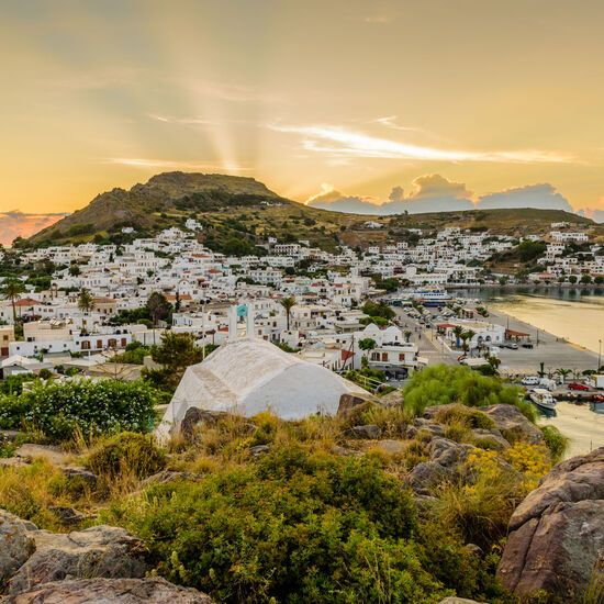 Beautiful sunset view of Skala village in Patmos island