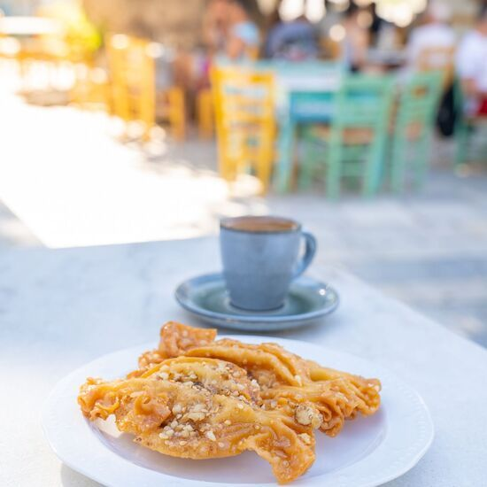 Don't leave Pyrgos village without trying local sweets in the village square!