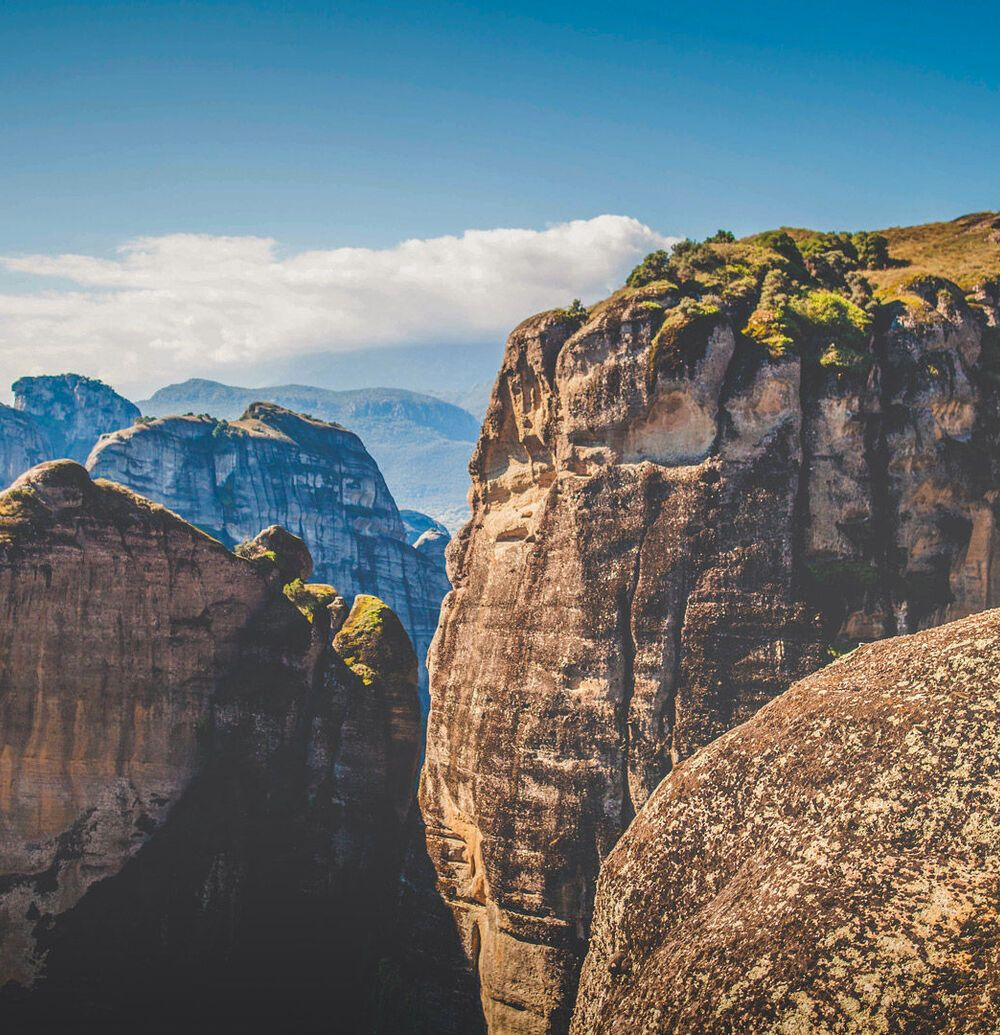 Walk among the gigantic rock pillars of Meteora to enjoy truly breathtaking views