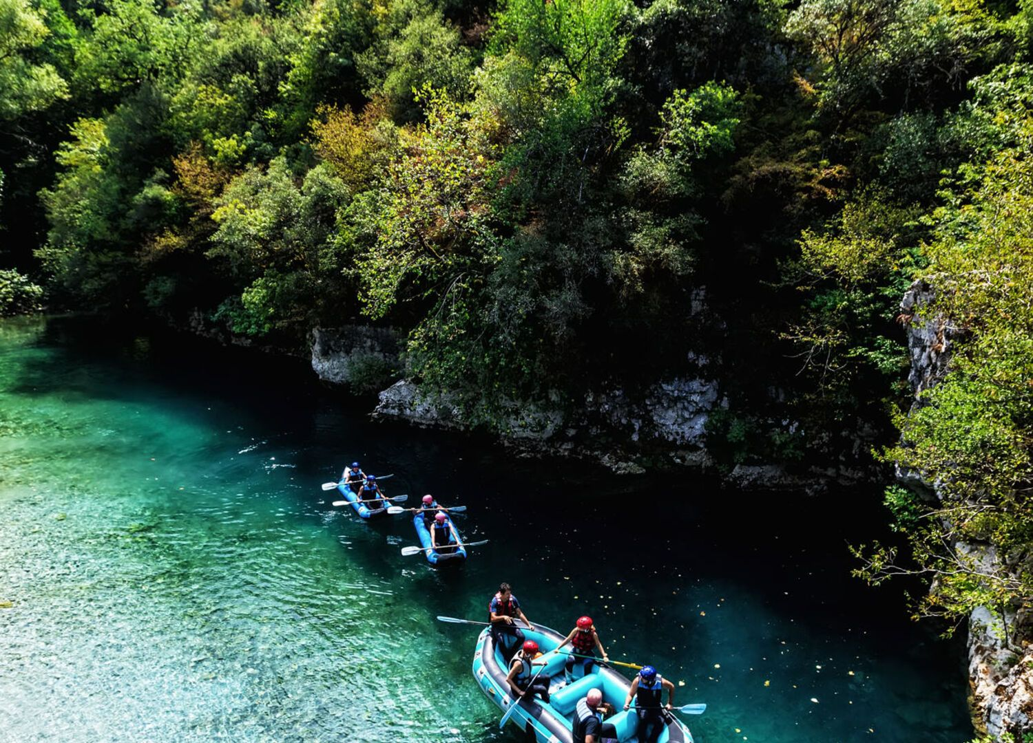 Adventure teams doing rafting on the cold waters of the Voidomatis River in Zagori. Voidomatis river is one of the most popular among rafters in Greece