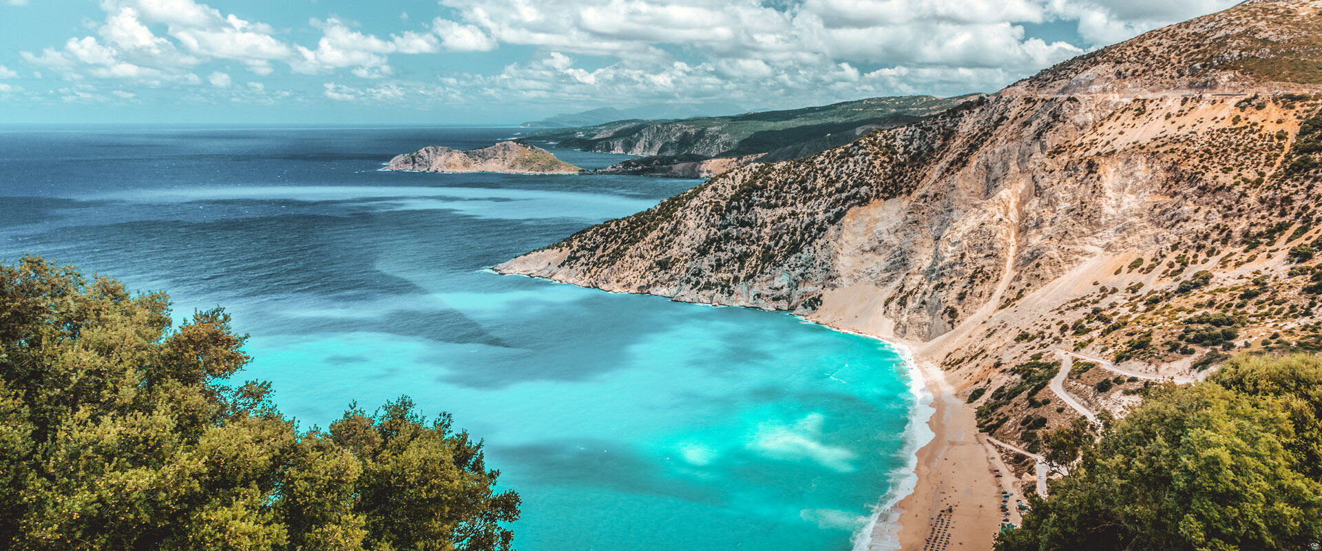 Beyond the serenity of the shimmering sea blues and greens, you can feel the immense power of nature everywhere - Myrtos Kefalonia