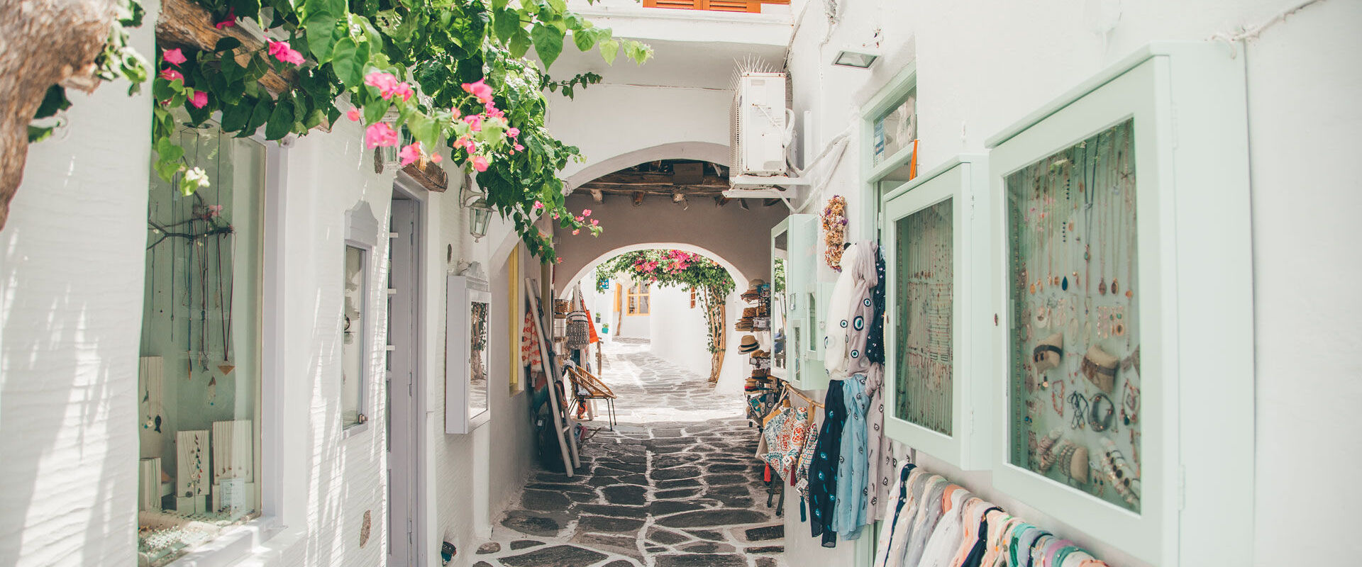 Disappear into the whitewashed alleyways, amidst the bougainvillea, cobblestones, souvenir shops and arts galleries